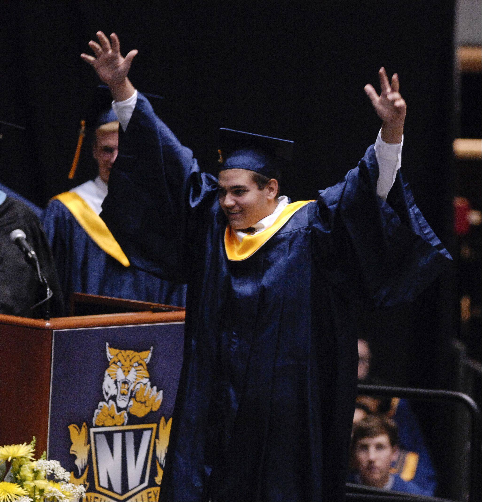 Graduate Zachary Thomas cheers as his name is called during the Neuqua Valley High School graduation on Sunday, May 26 at the NIU Convocation Center in DeKalb.