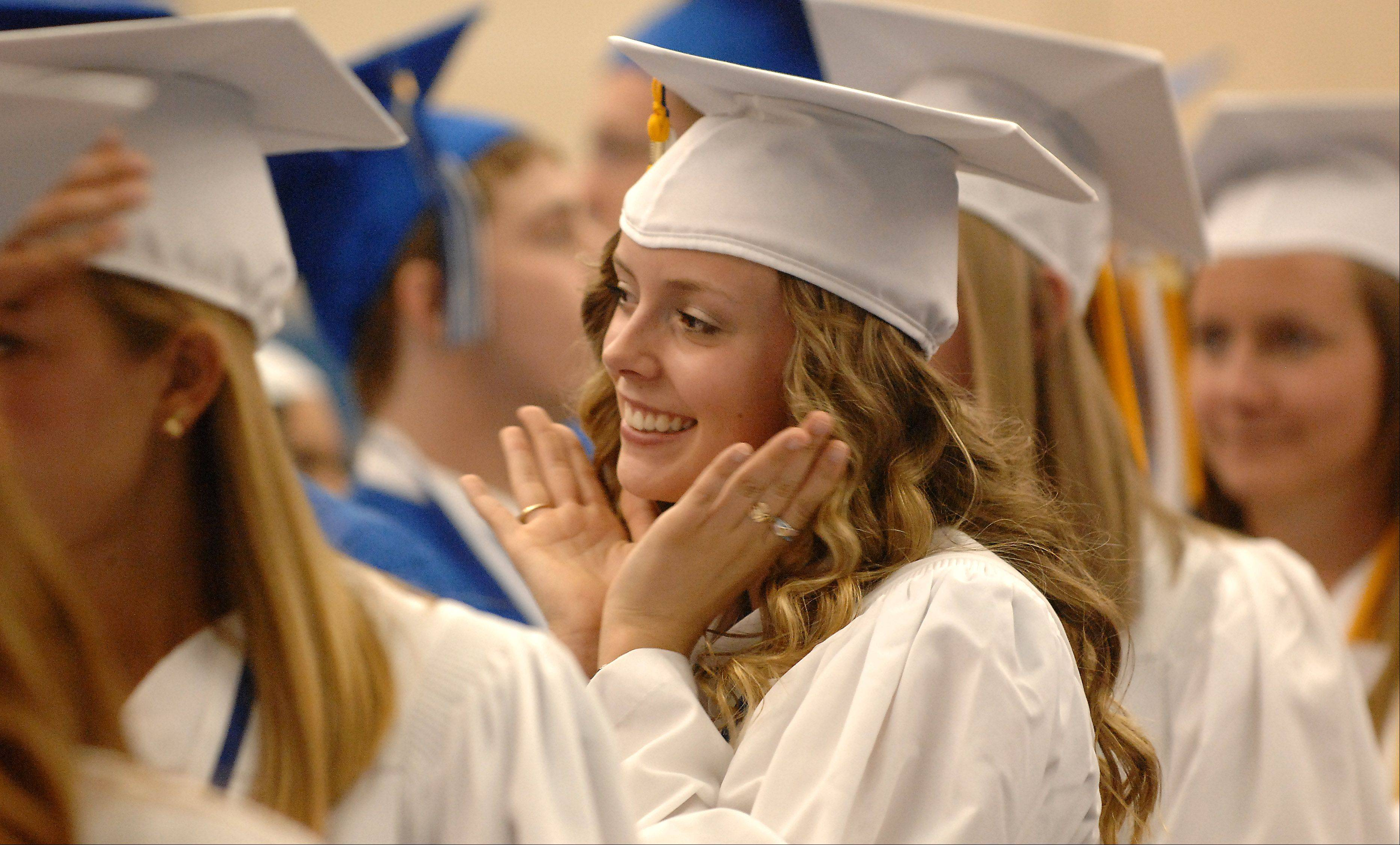 Kathryn Carley smiles for a picture by a classmate during Geneva High School's commencement ceremony Sunday.