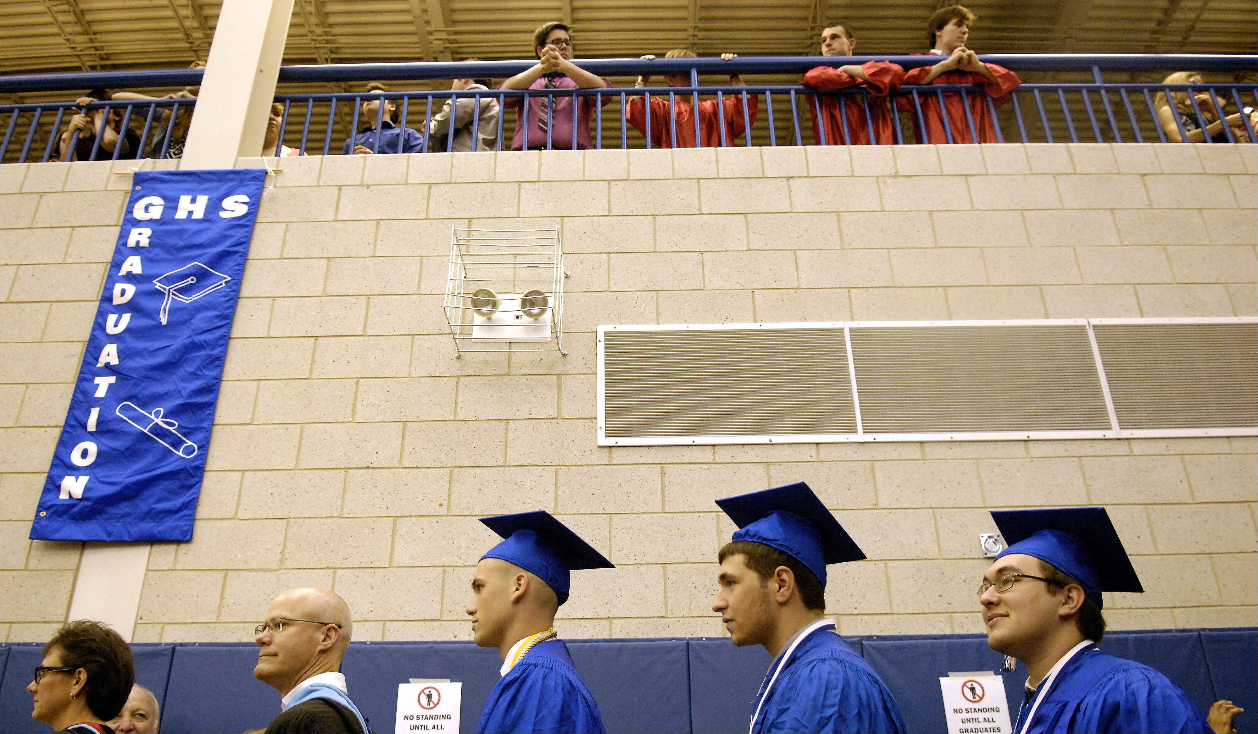 The 2013 senior class files in to the gym to start Geneva High School's commencement ceremony Sunday.