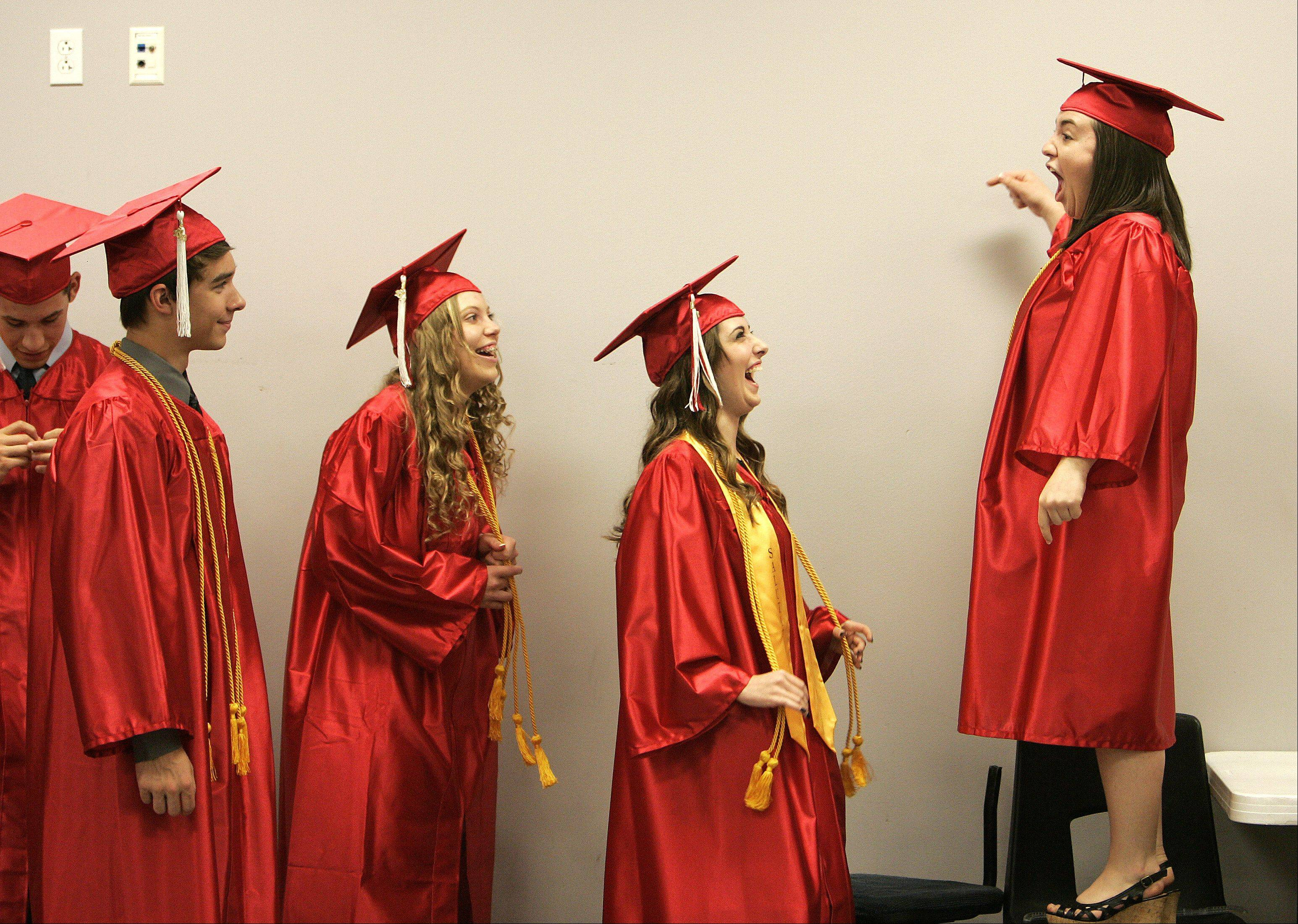 Keagan Johnson, right, jokingly lectures some of her fellow students before Aurora Christian's commencement ceremony Sunday, May 26, 2013 in Aurora.