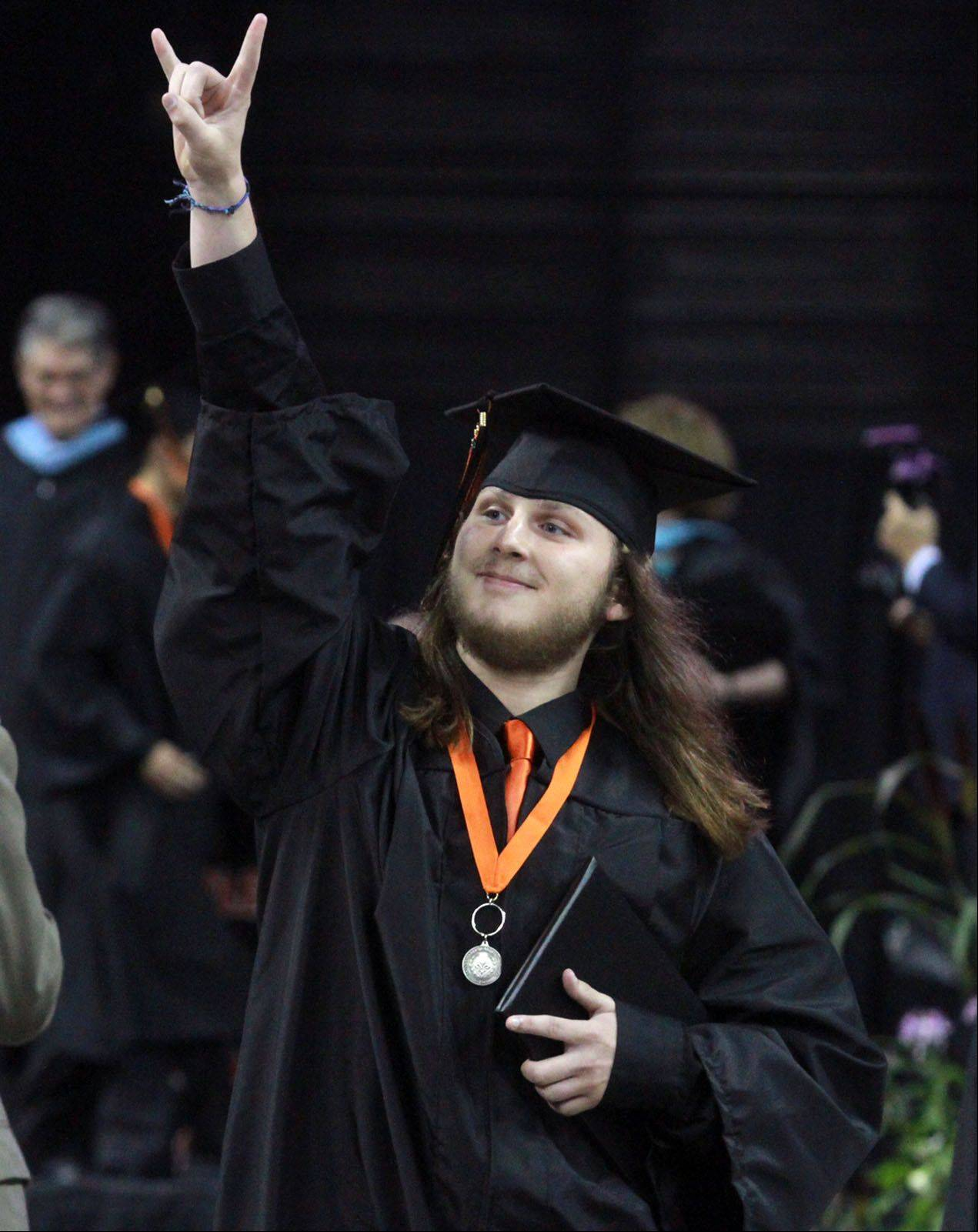 Zachary Utley celebrates getting his diploma as he walks offstage during St. Charles East High School commencement ceremony at the Sears Centre in Hoffman Estates on Sunday, May 26, 2013.