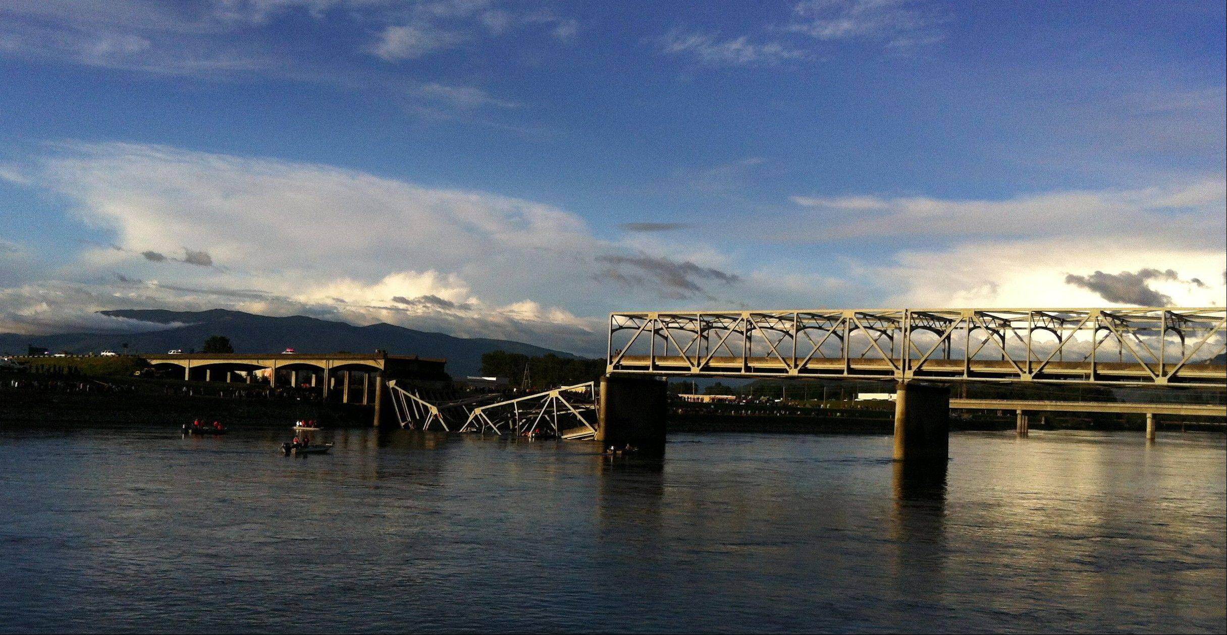 A portion of the Interstate 5 bridge is submerged after it collapsed into the Skagit River in Mount Vernon, Wash., Thursday, May 23, 2013.