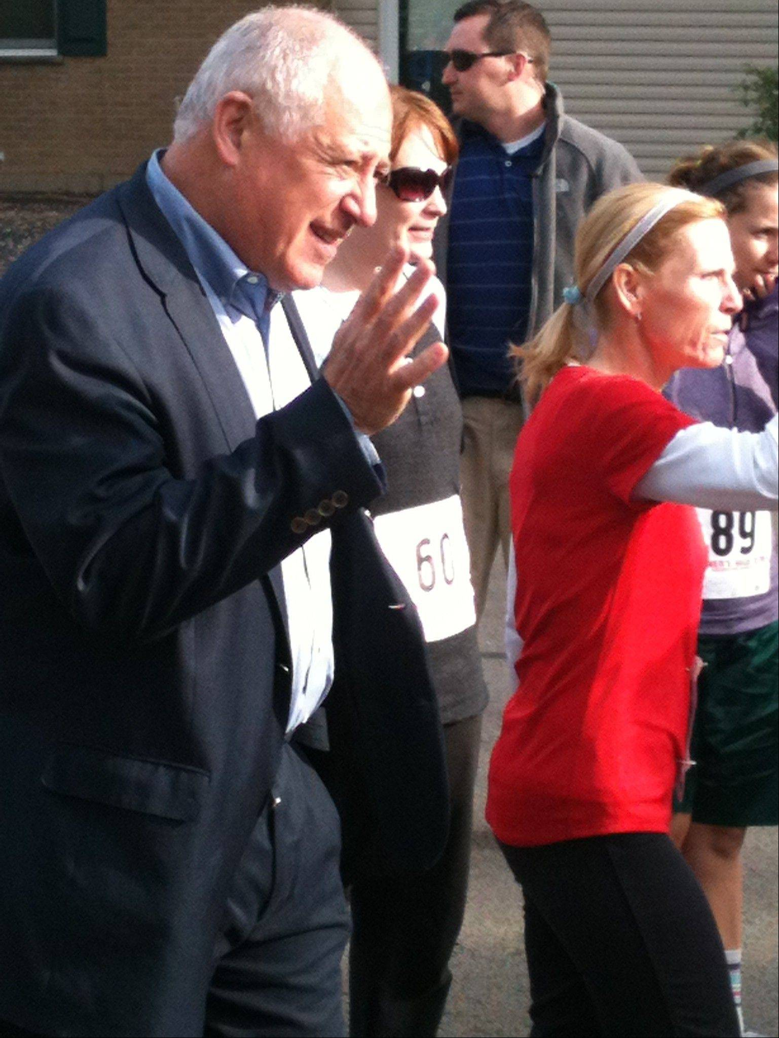Gov. Pat Quinn waves to the runners at the 10th annual Got Freedom? run held Sunday in Arlington Heights.