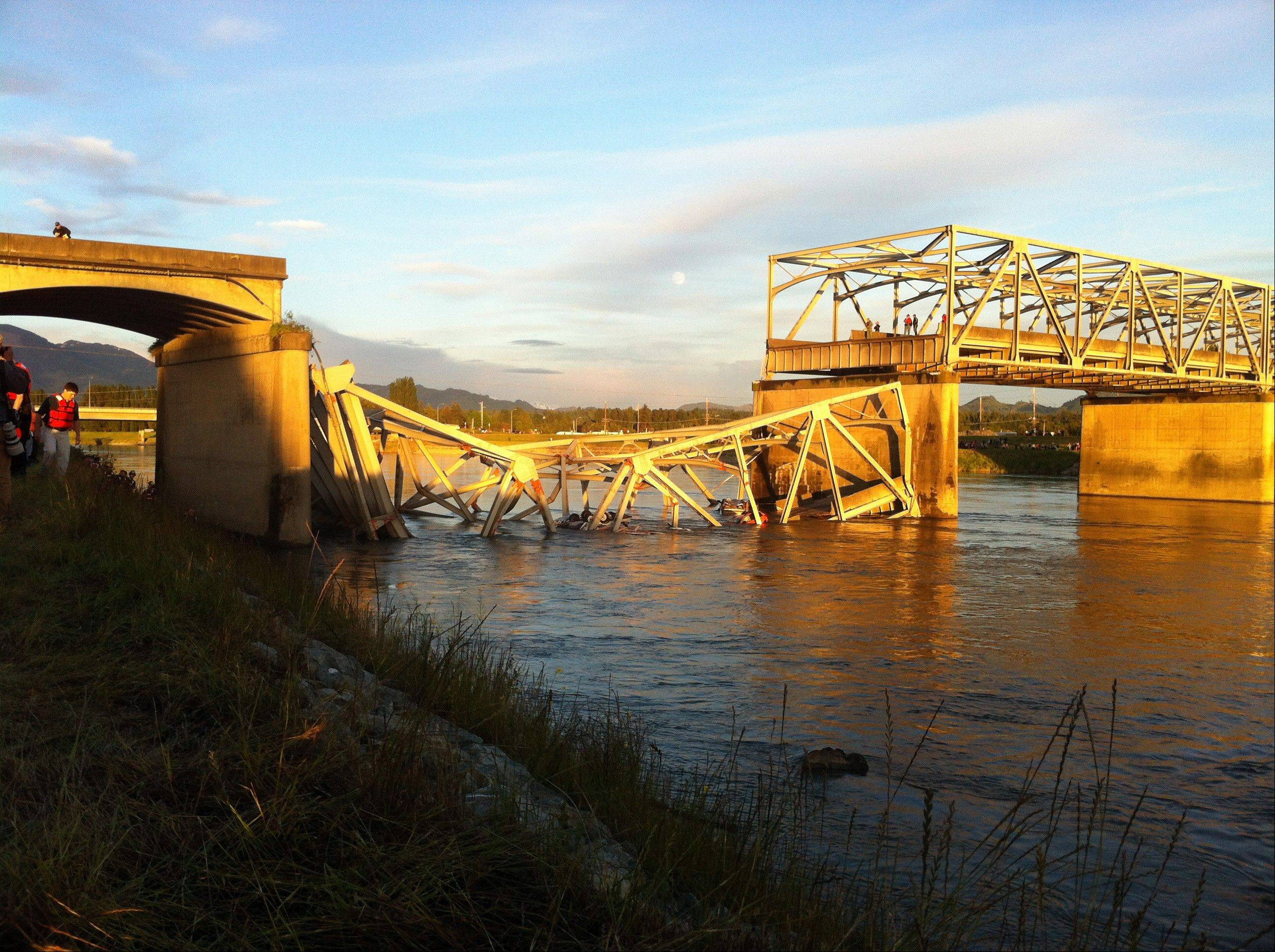 A portion of the Interstate 5 bridge is submerged after it collapsed into the Skagit River dumping vehicles and people into the water in Mount Vernon, Wash., Thursday, May 23, 2013 according to the Washington State Patrol.
