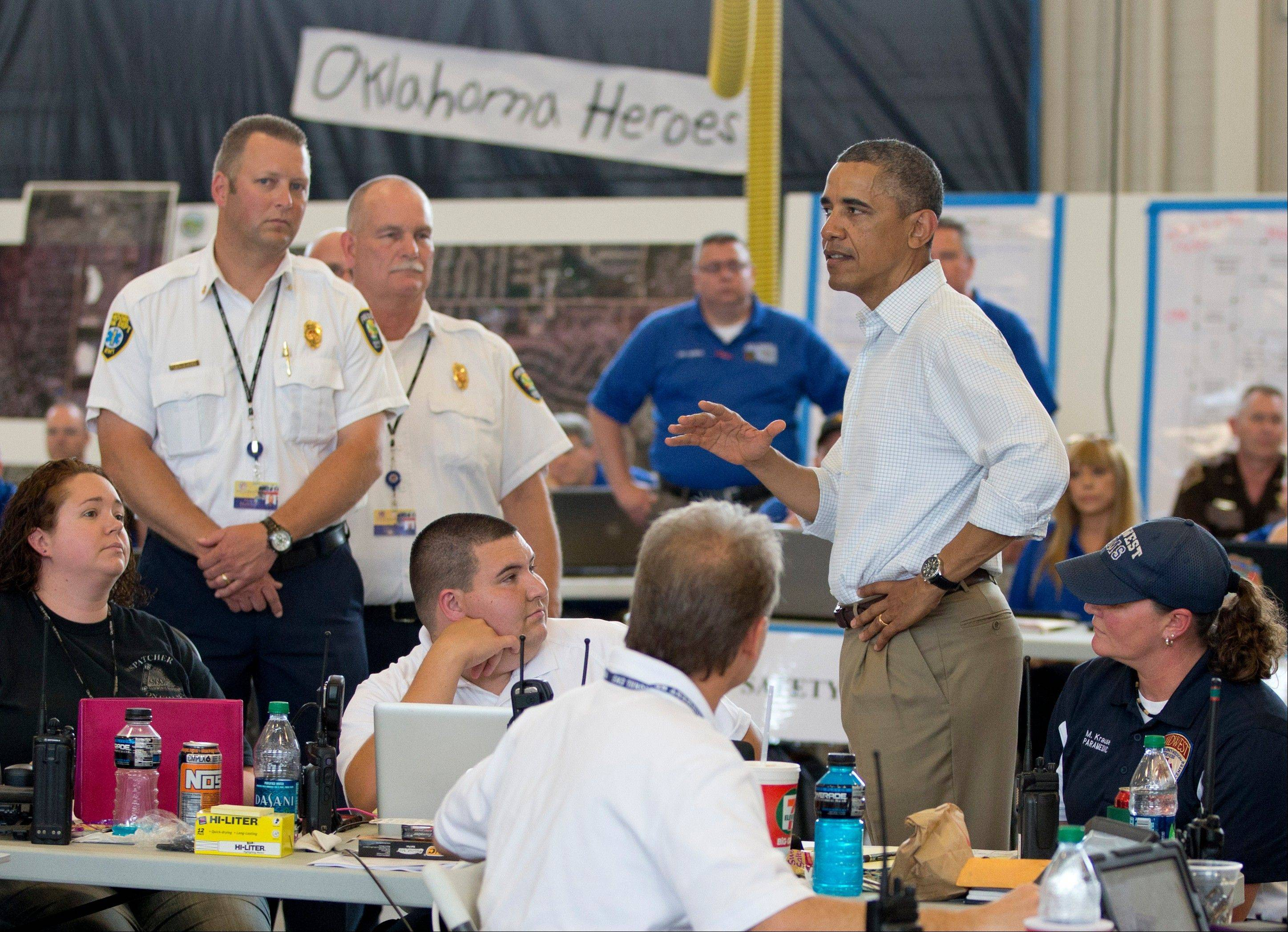 President Barack Obama meets with first responders during a tour of the devastation in Moore, Okla., Sunday, May 26, 2013, after the massive tornado and severe weather the week before.