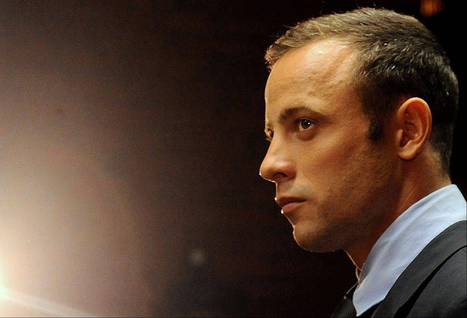 In this photo taken Friday, Feb. 26, 2013 file photo, Olympic athlete, Oscar Pistorius appears in court for his bail hearing after being charged with the shooting of his girlfriend, Reeva Steenkamp, in Pretoria, South Africa.