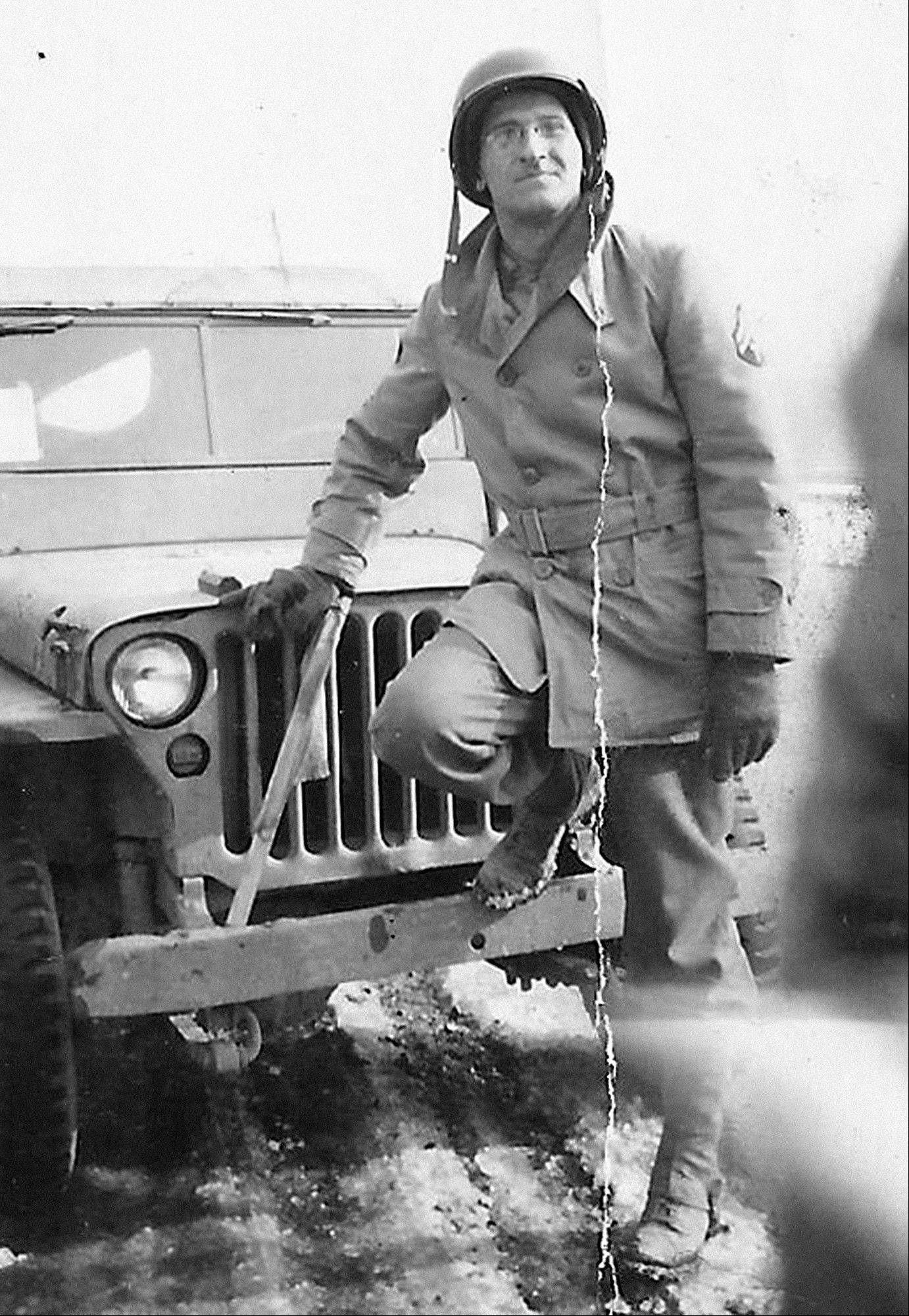 This World War II-era photo provided by the family shows Morton Tuller next to a jeep. As a young soldier in the Army Signal Corps, he served as a cryptologist with a high-security clearance post deciphering American codes sent ship-to-ship in the European and Pacific theaters. For decades, he told no one, not even his wife, about his work on Navy ships that landed in Sicily, southern France, north Africa, Okinawa and Iwo Jima.
