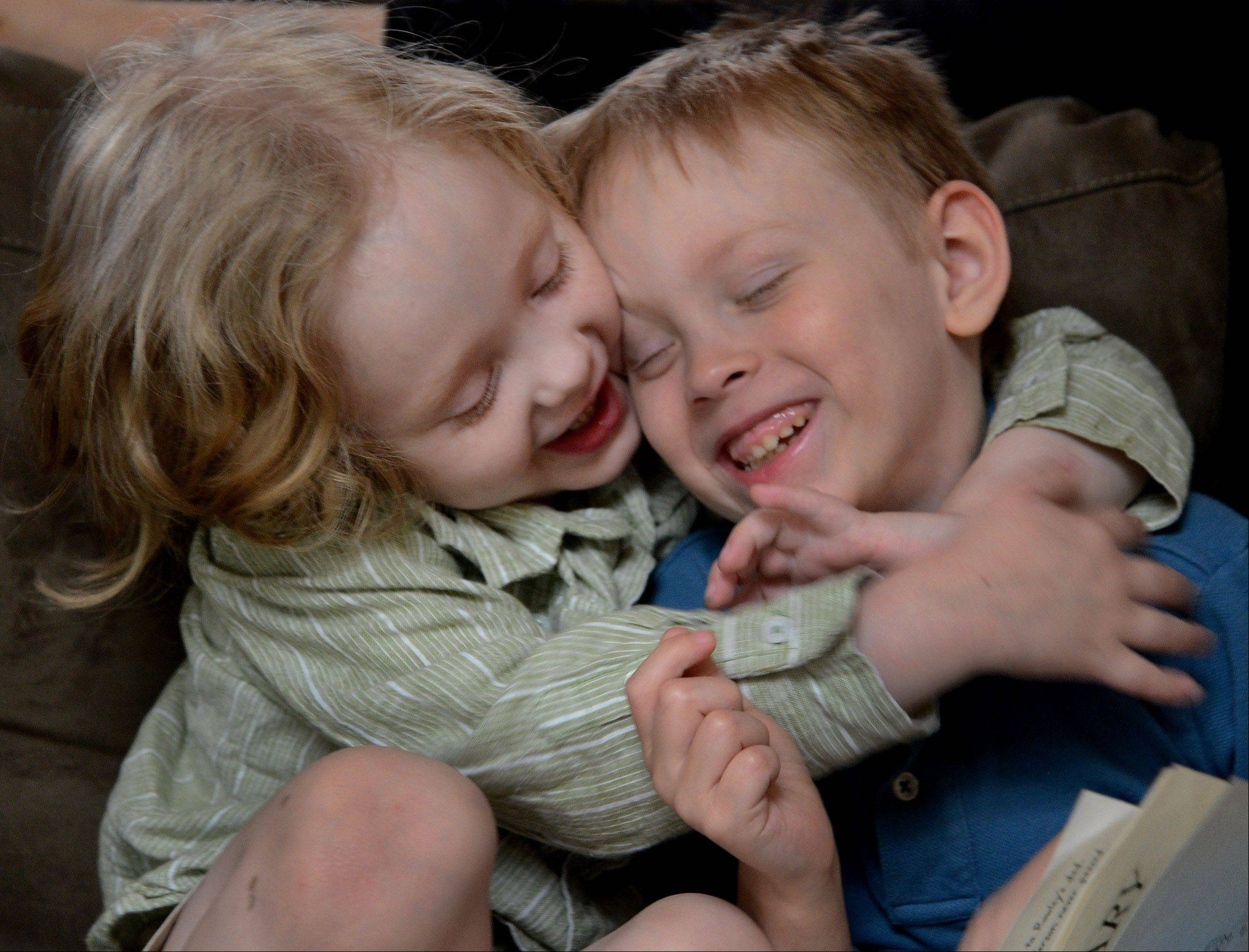 Liver transplant twins, Jake, left, and Luke Swanson, play with each other.