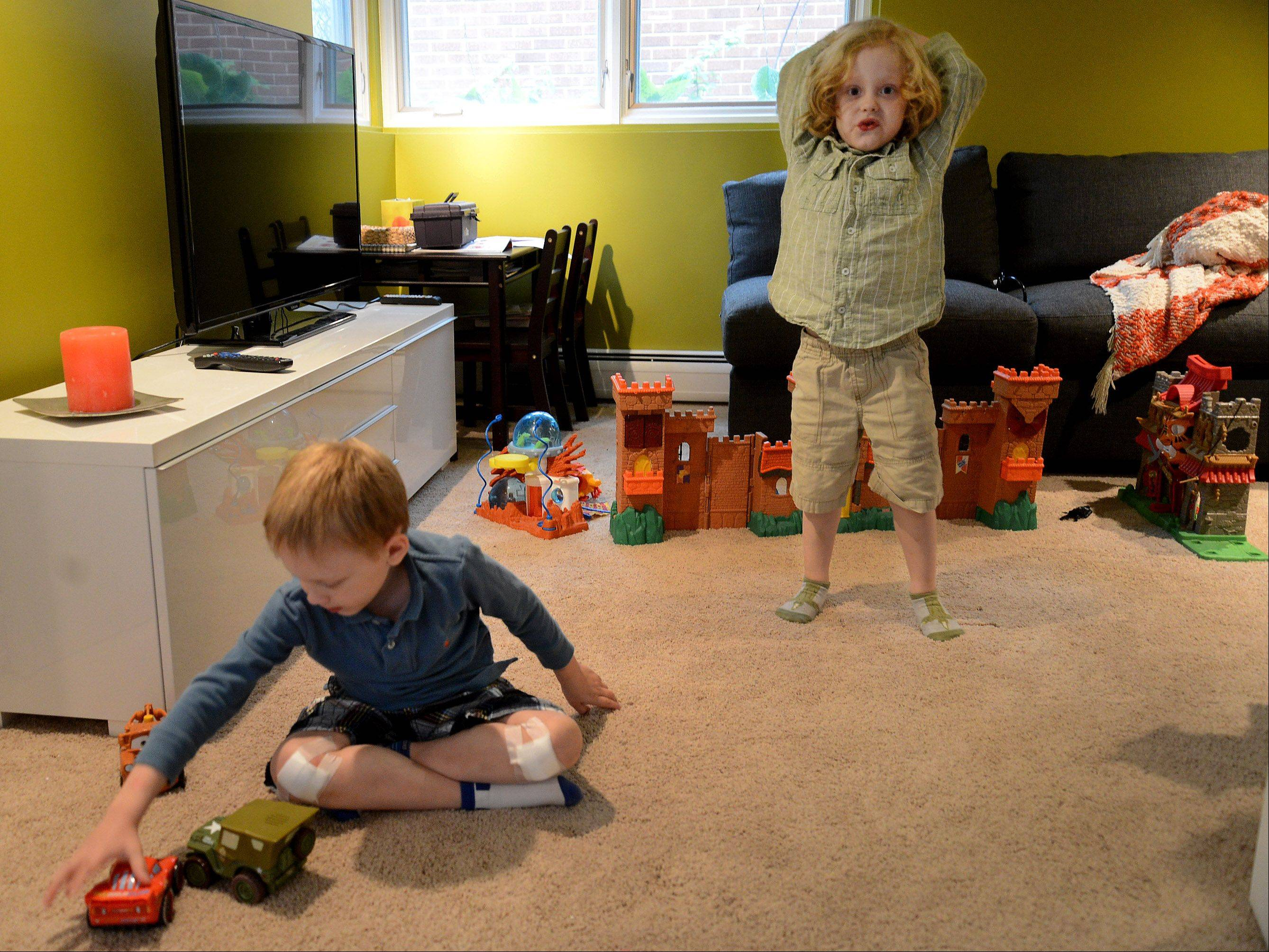 Luke, left, and Jake Swanson play in their playroom.
