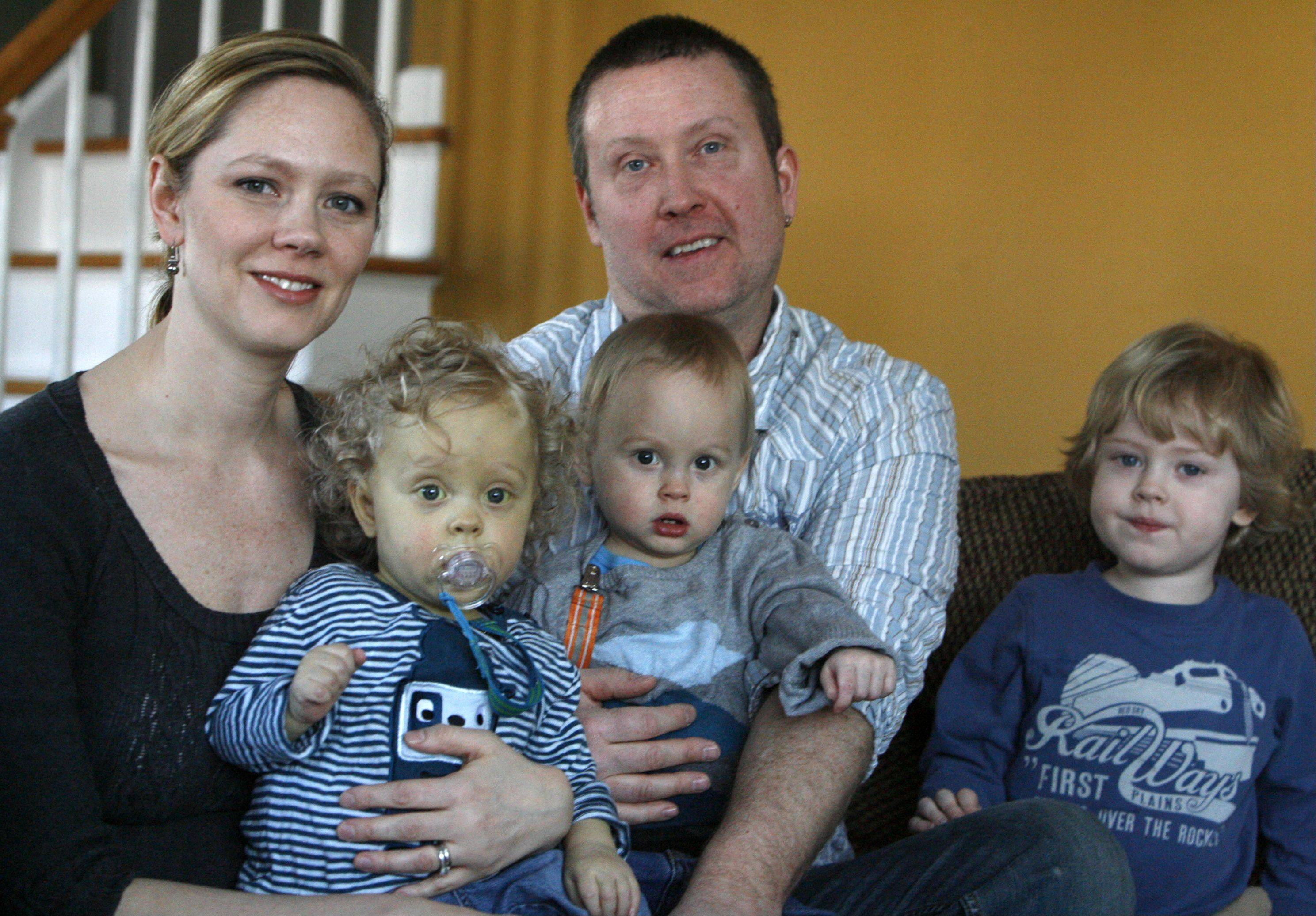 Then 17-month-old twins Jake, left, and Luke with their parents Robyn and Scott Swanson and their brother Gunnar in 2010.