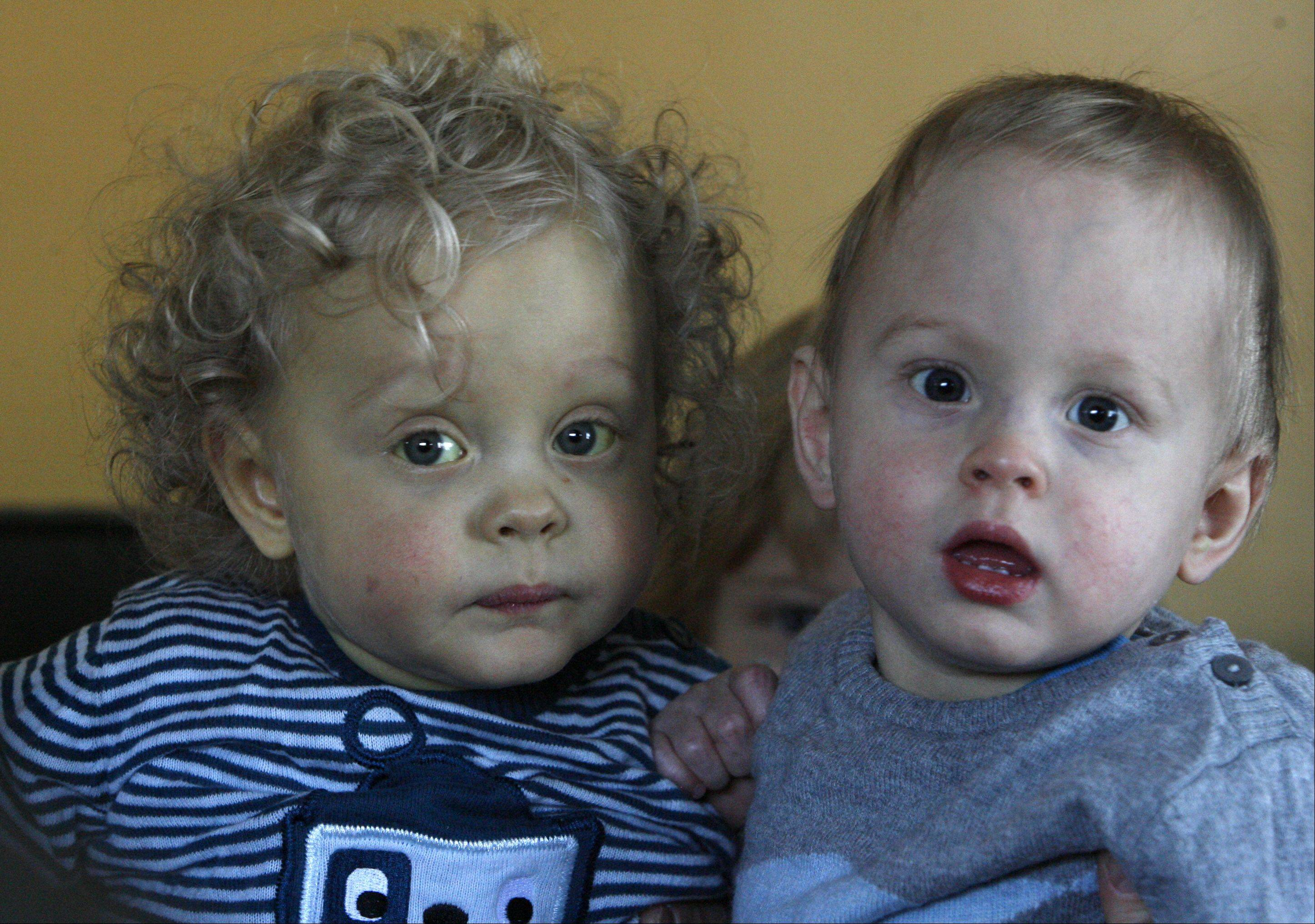 Then 17-month-old twins Jake, left, and Luke Swanson of Arlington Heights are the only documented case of twins in the U.S. or Canada that needed liver transplants due to a rare condition called biliary atresia.