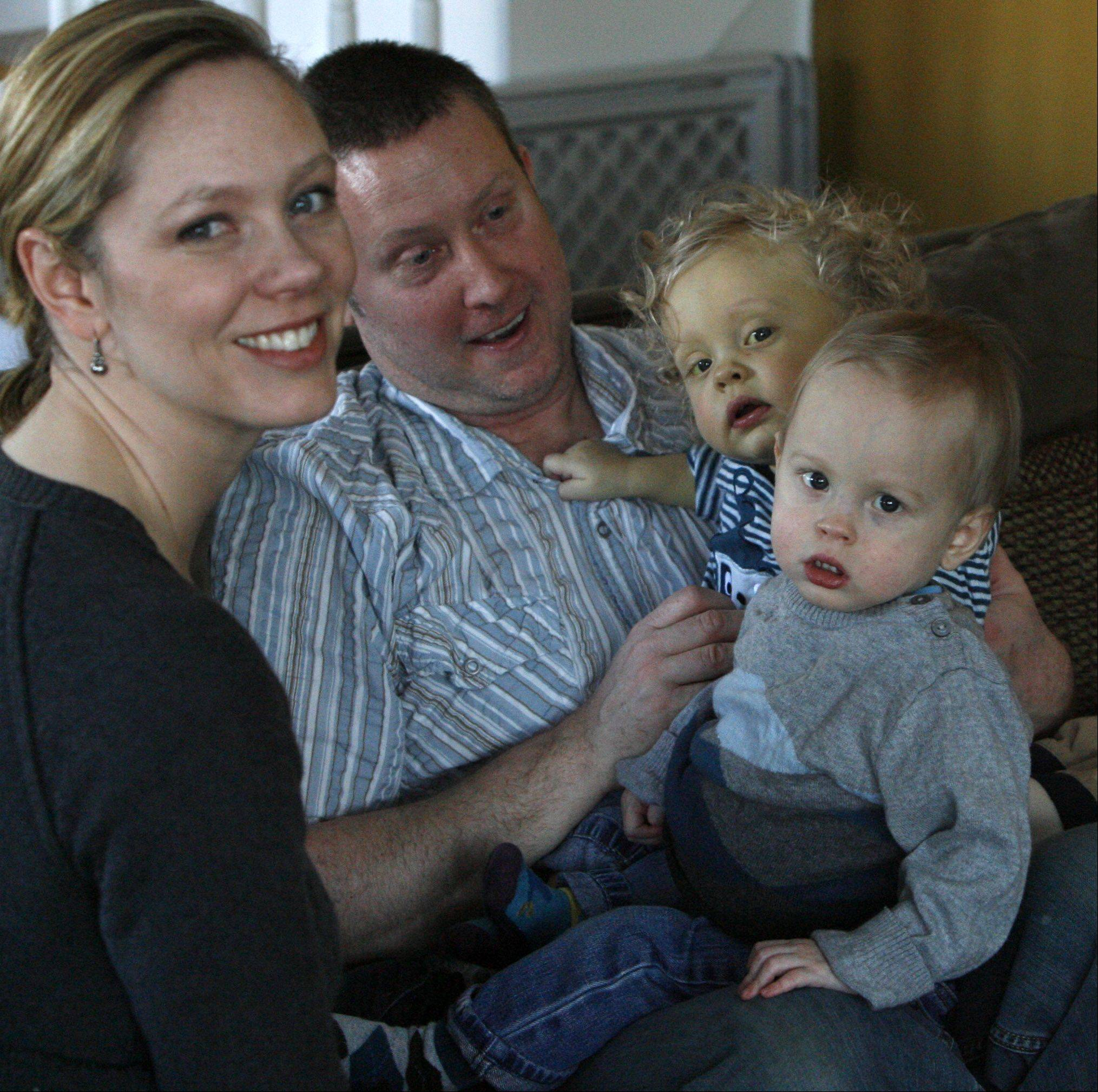Then 17-month-old twins Luke, foreground, and Jake with their parents Robyn and Scott Swanson and their brother Gunnar in 2010. Luke and Jake are the only documented case of twins in the U.S. or Canada that needed liver transplants due to a rare condition called biliary atresia.
