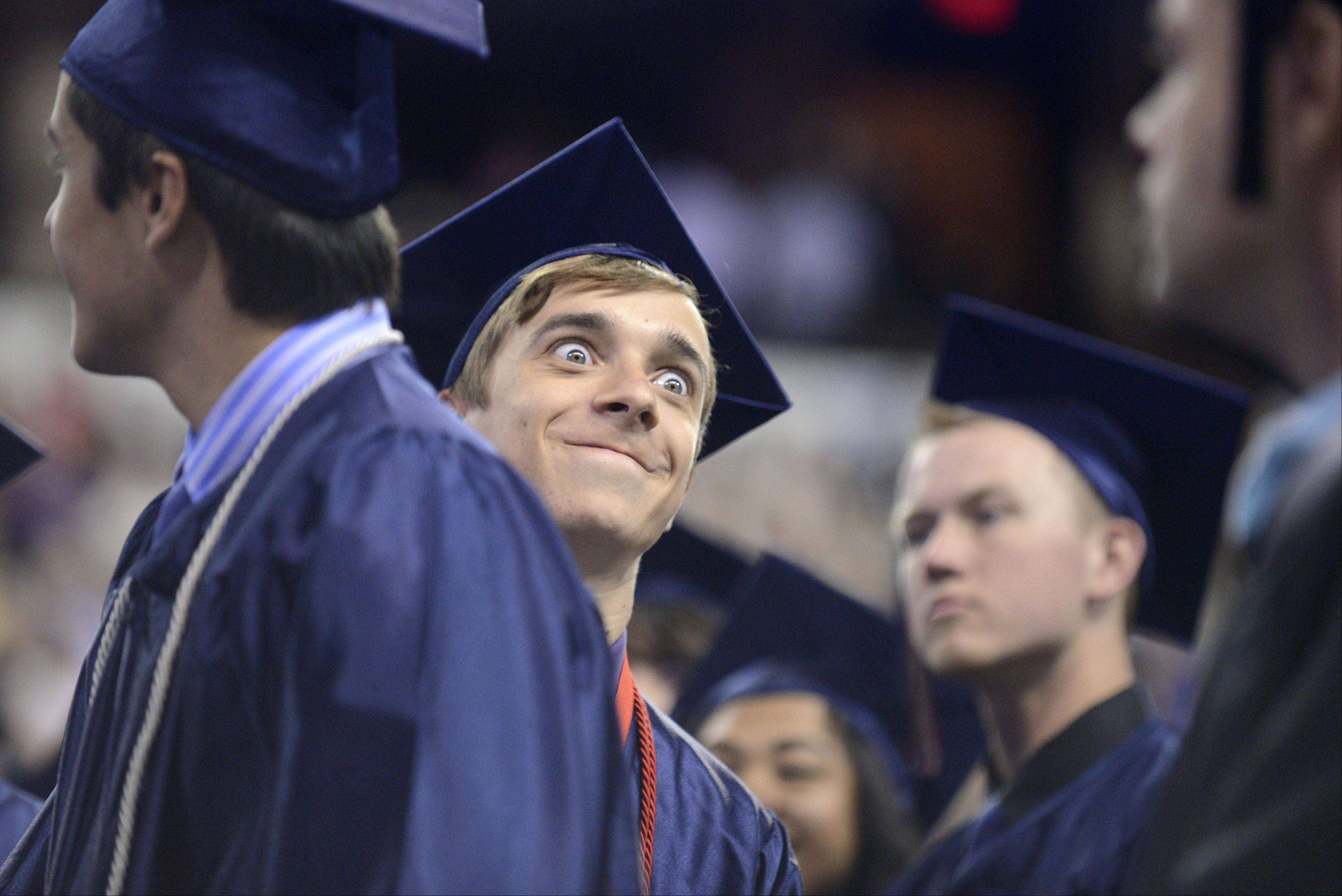 Shane Spikes has fun during South Elgin High School's commencement ceremony at the Sears Centre in Hoffman Estates on Saturday.