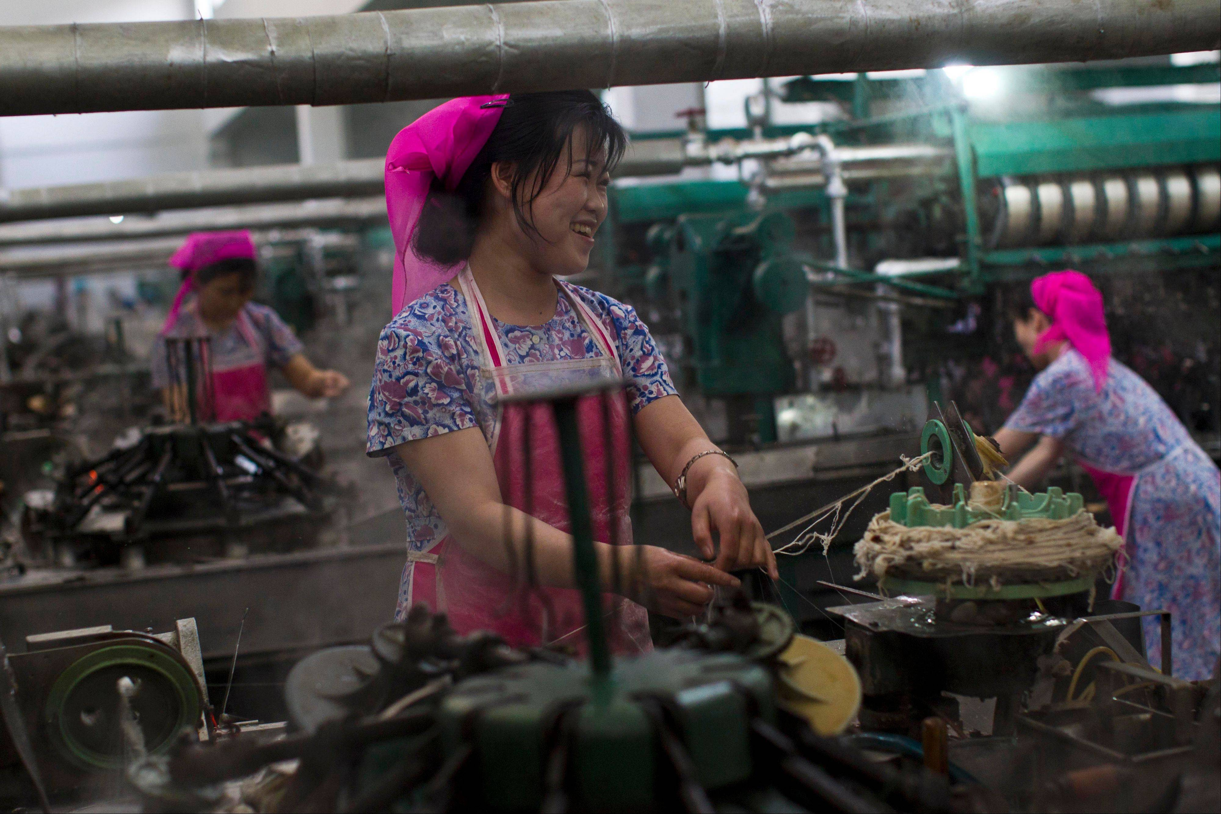 In this Monday, April 9, 2012 photo, North Korean women work in a thread factory in Pyongyang, North Korea. A North Korean economist said that the government introduced new economic management methods in April 2013 that relax state control of workers' salaries. (AP Photo/David Guttenfelder)