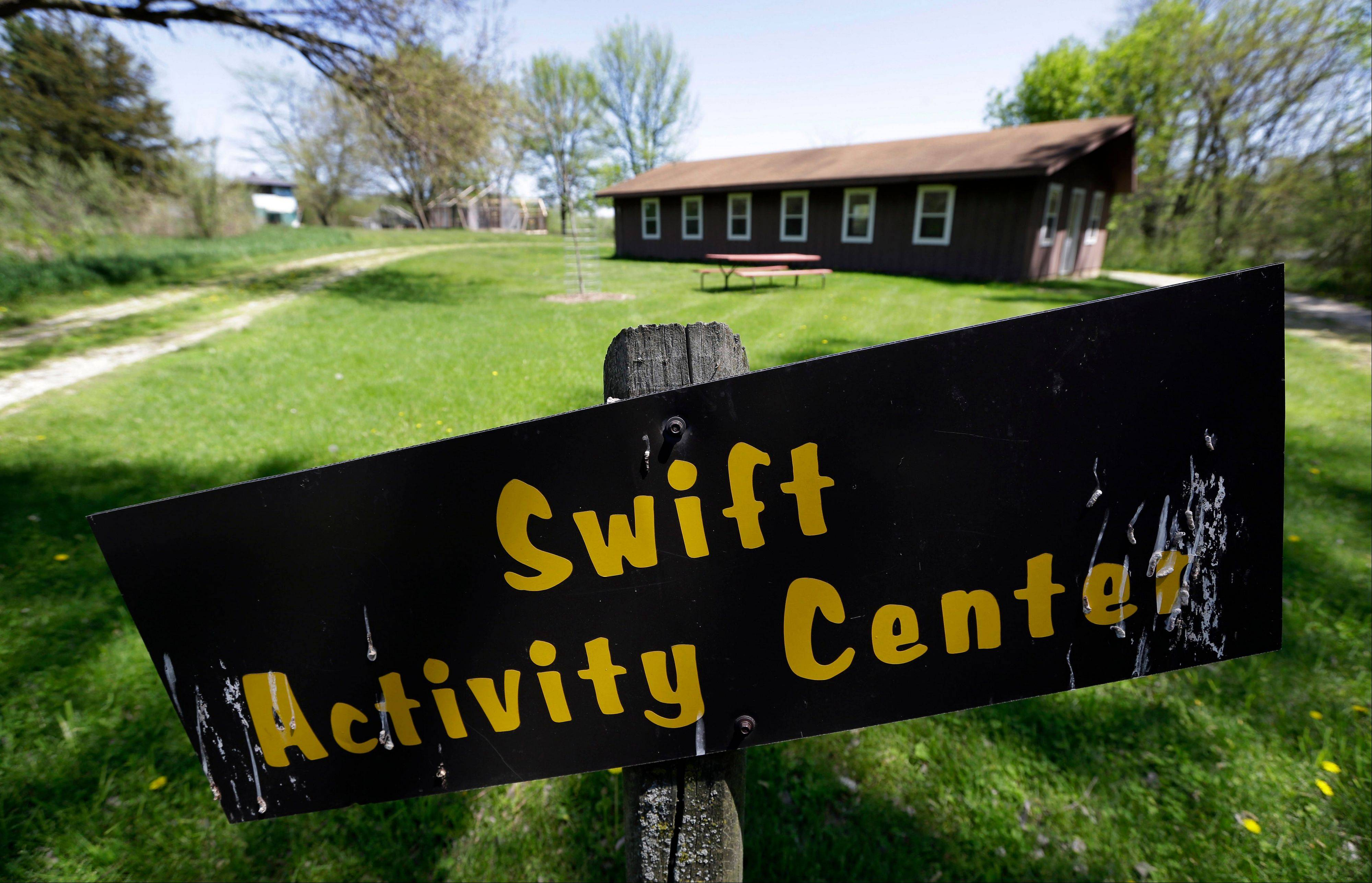 This Tuesday, May 14, 2013 photo shows the Swift Activity Center at the Camp Conestoga Girls Scouts camp in New Liberty, Iowa. In an effort to save money, Girl Scout councils across the country are making proposals that would have been unthinkable a generation ago: selling summer camps that date back to the 1950s.