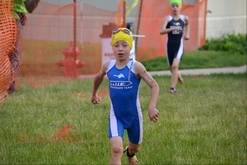 Chase Brennan, 6, of Aurora, runs from the pool at Cadence Health and Fitness Center in Geneva to where his bike is waiting. Brennan finished first in his age category of 6- to 8-year-olds during Sunday's triathlon, now in its 13th year. It is organized by Multisport Madness Triathlon Team.