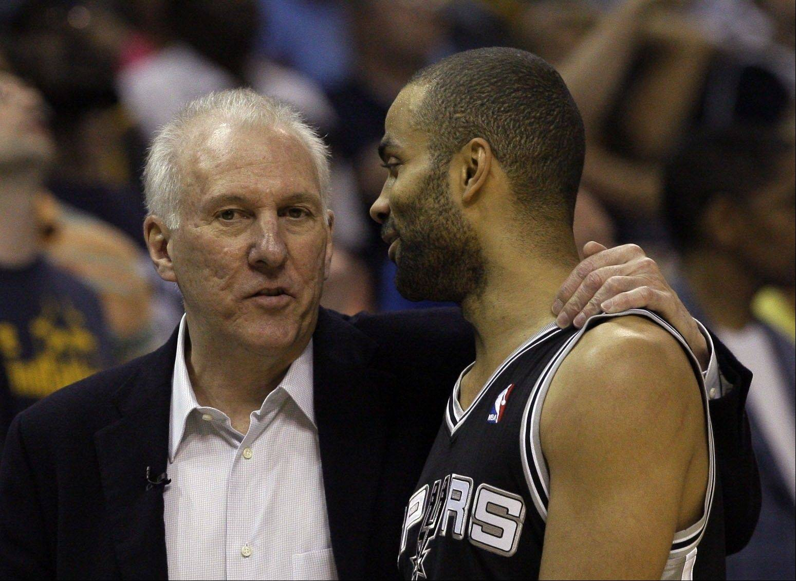 San Antonio Spurs head coach Gregg Popovich, left, talks to San Antonio Spurs guard Tony Parker during a timeout in the first half of Game 4 of the Western Conference finals NBA basketball playoff series against the Memphis Grizzlies, in Memphis, Tenn., Monday, May 27, 2013.