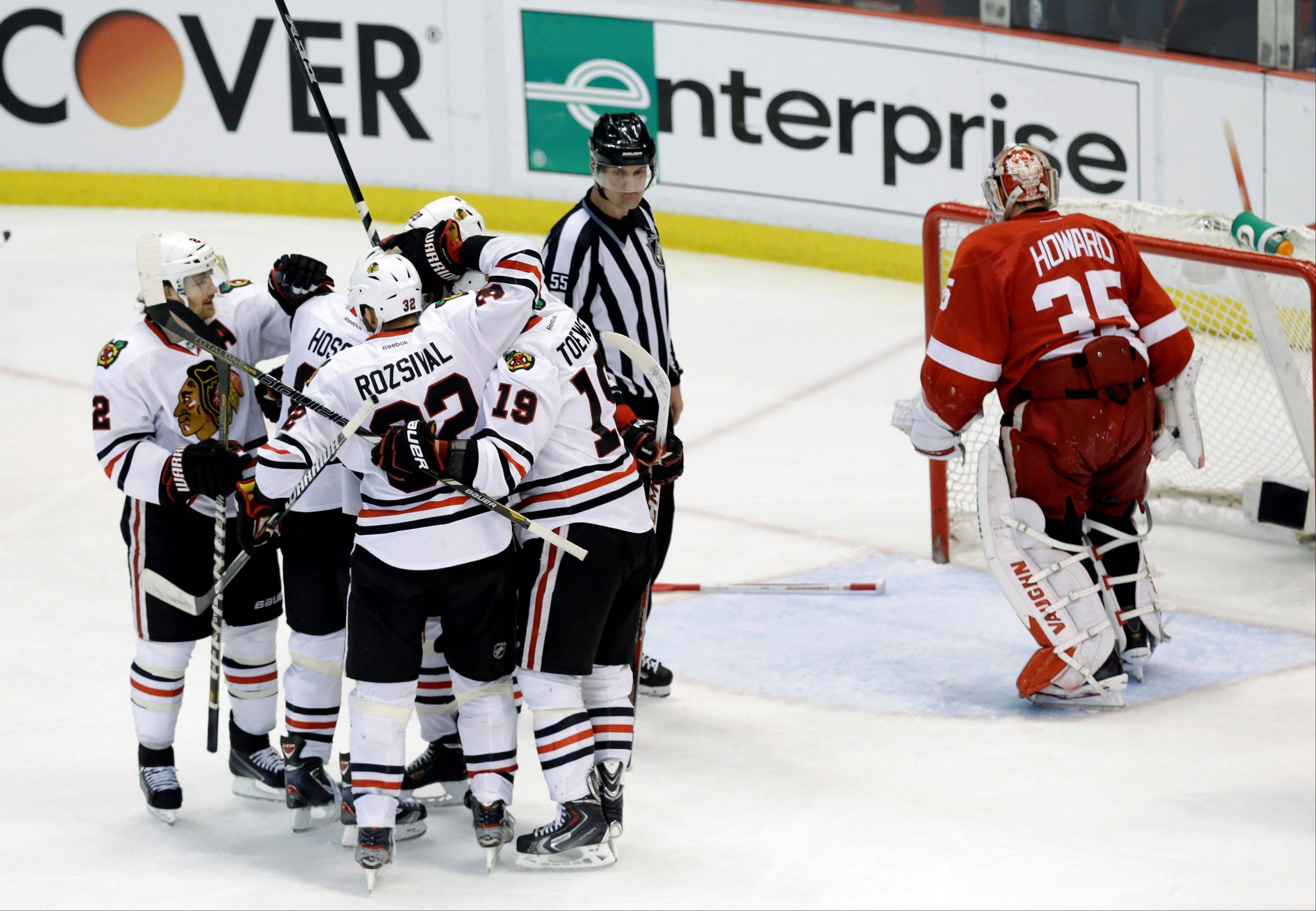Chicago Blackhawks left wing Bryan Bickell (29) celebrates scoring a goal against the Detroit Red Wings with teammates during the third period in Game 6 of the Western Conference semifinals in the NHL hockey Stanley Cup playoffs in Detroit, Monday, May 27, 2013.
