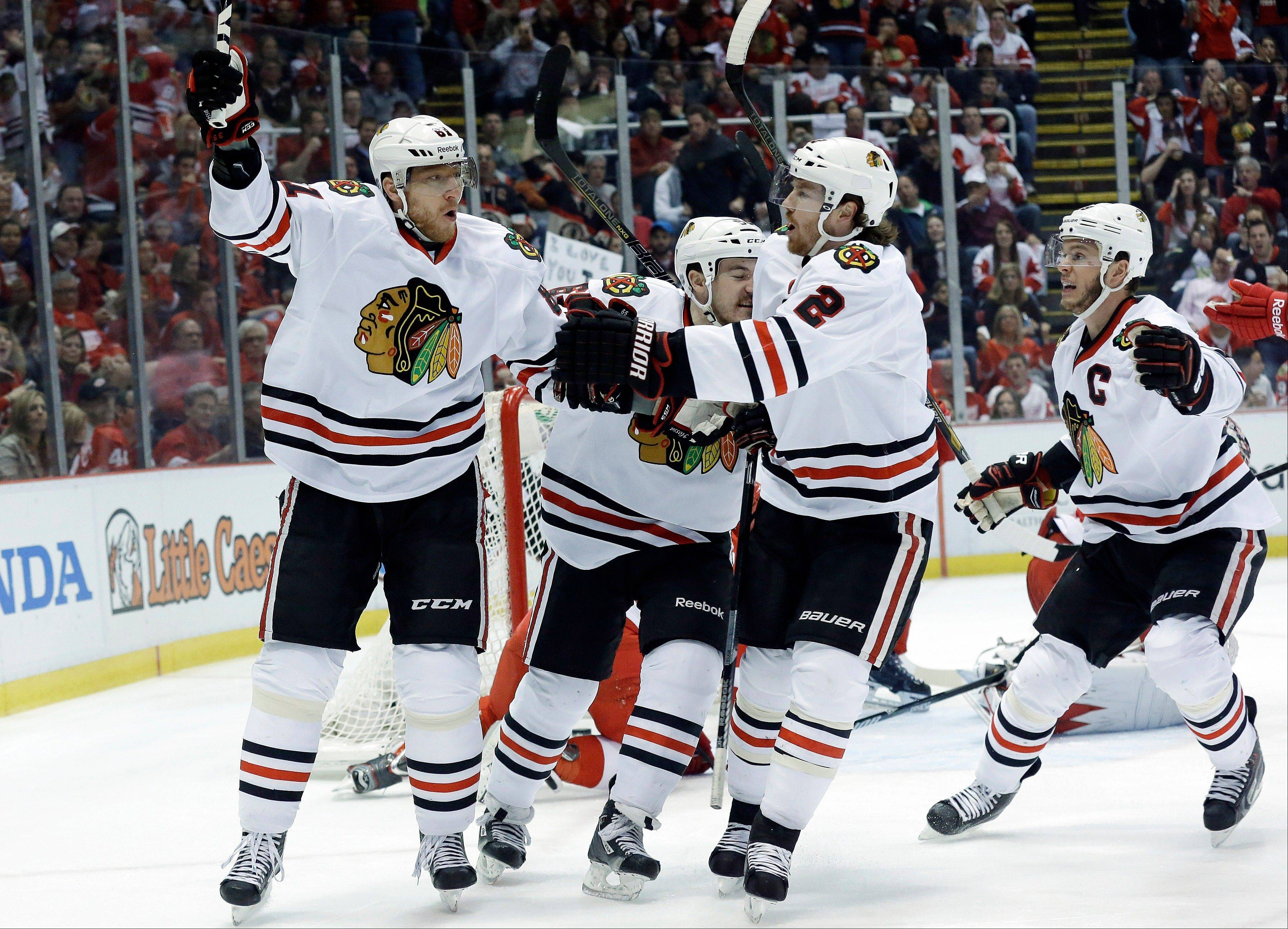 Blackhawks right wing Marian Hossa, left, celebrates his goal against the Detroit Red Wings with Andrew Shaw, Duncan Keith and Jonathan Toews during Monday�s first period in Detroit.