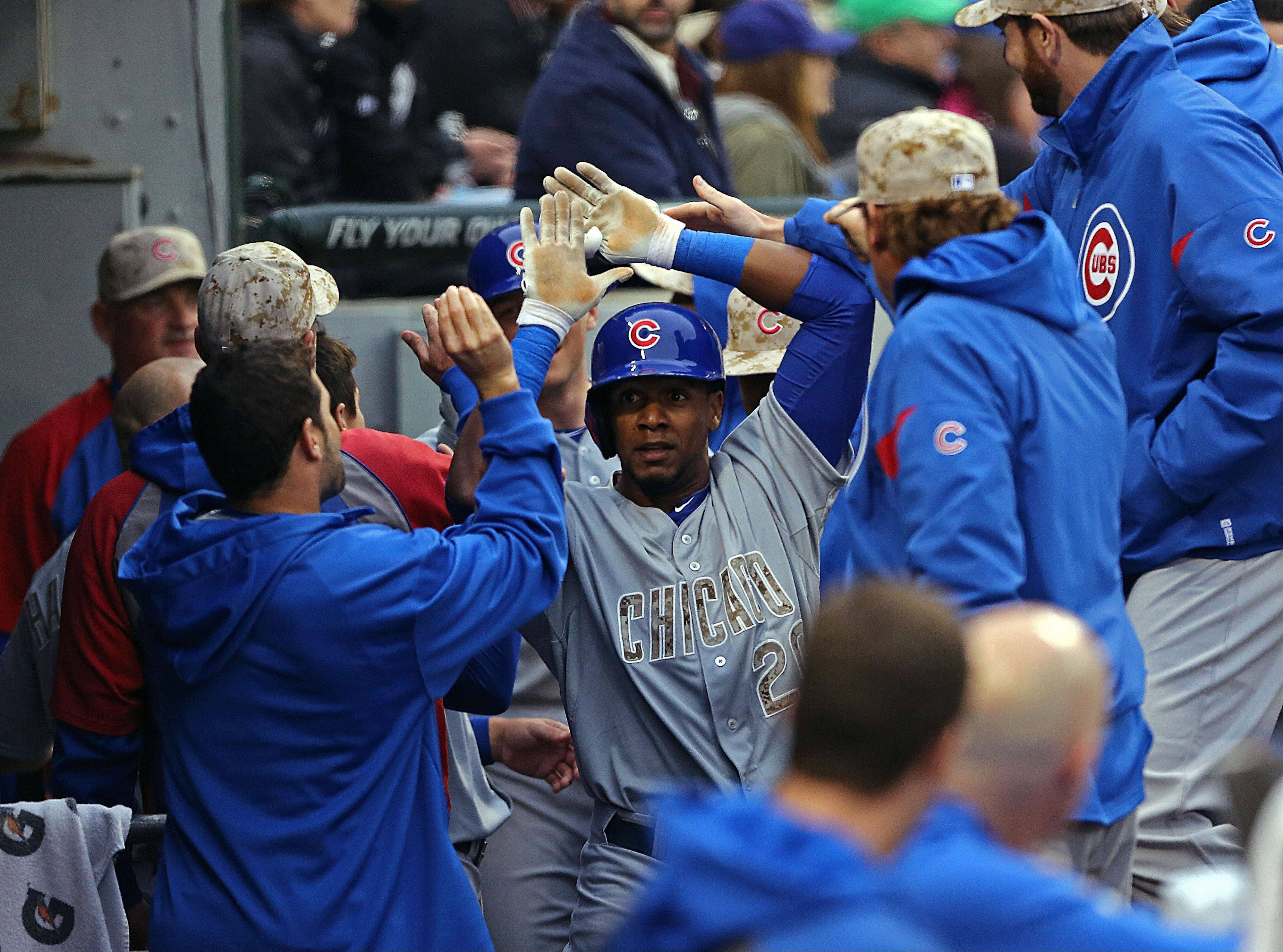 Cubs outfielder Julio Borbon gets high fives in the dugout after hitting a two-run homer in the fifth inning, giving the Cubs a 3-0 lead over the White Sox at U.S. Cellular Field.