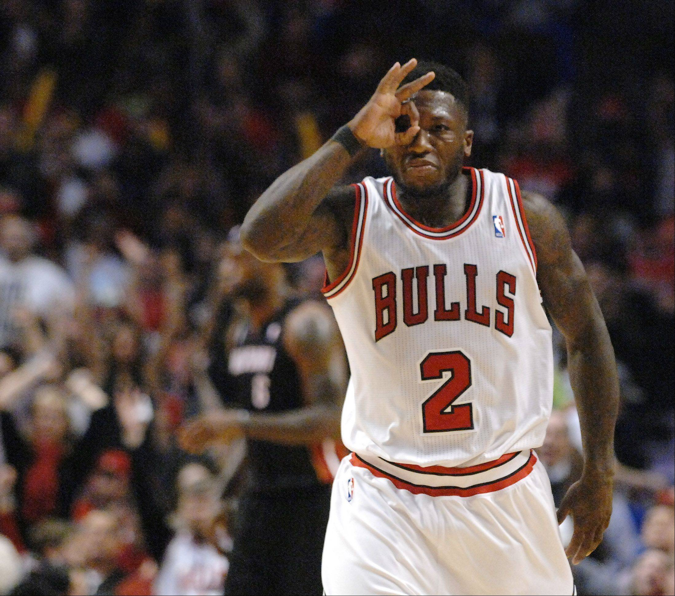 Bulls point guard Nate Robinson celebrates a three-pointer during the NBA playoffs. If his instant offense attracts offers from other teams, the Bulls will likely lose him.