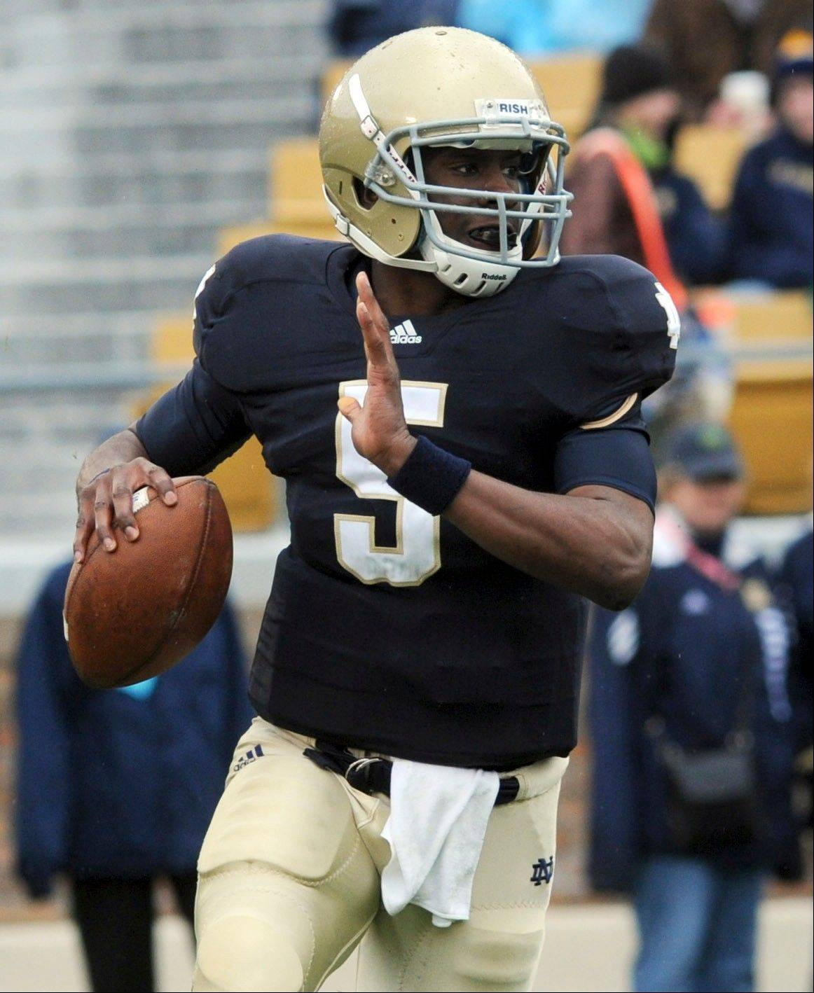 FILE - In this April 16, 2011, file photo, Notre Dame quarterback Everett Golson sprints out of the pocket during the first half of a spring NCAA college football game in South Bend, Ind. A Notre Dame spokesman says Golson is no longer enrolled at the school. (AP Photo/Joe Raymond, File)
