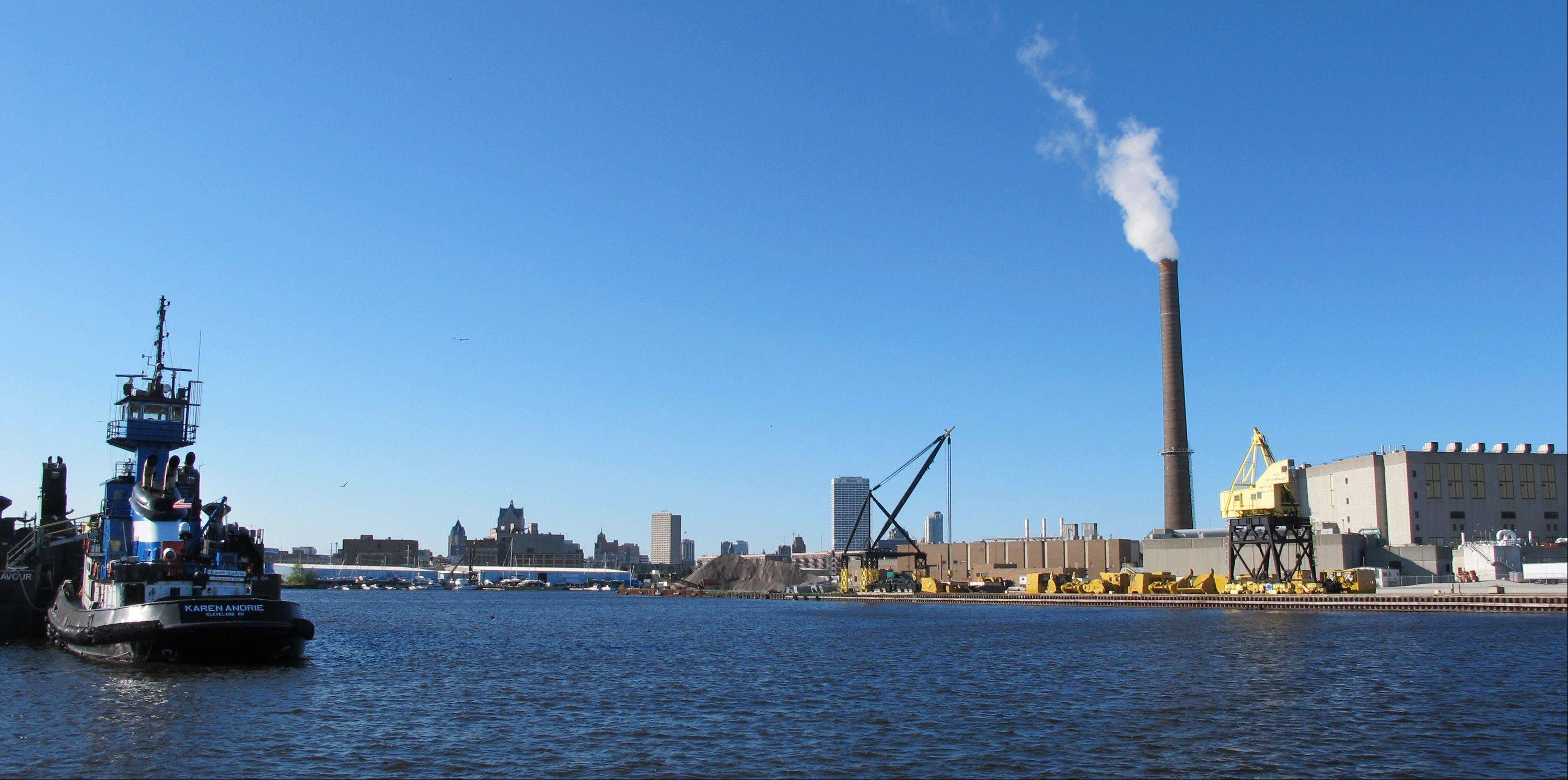 This May 23, 2013, photo shows a view of downtown Milwaukee from the Kinnickinnic River, not far from where it connects with Lake Michigan. Milwaukee officials hope its proximity to water provides the backbone to a revitalized economy.