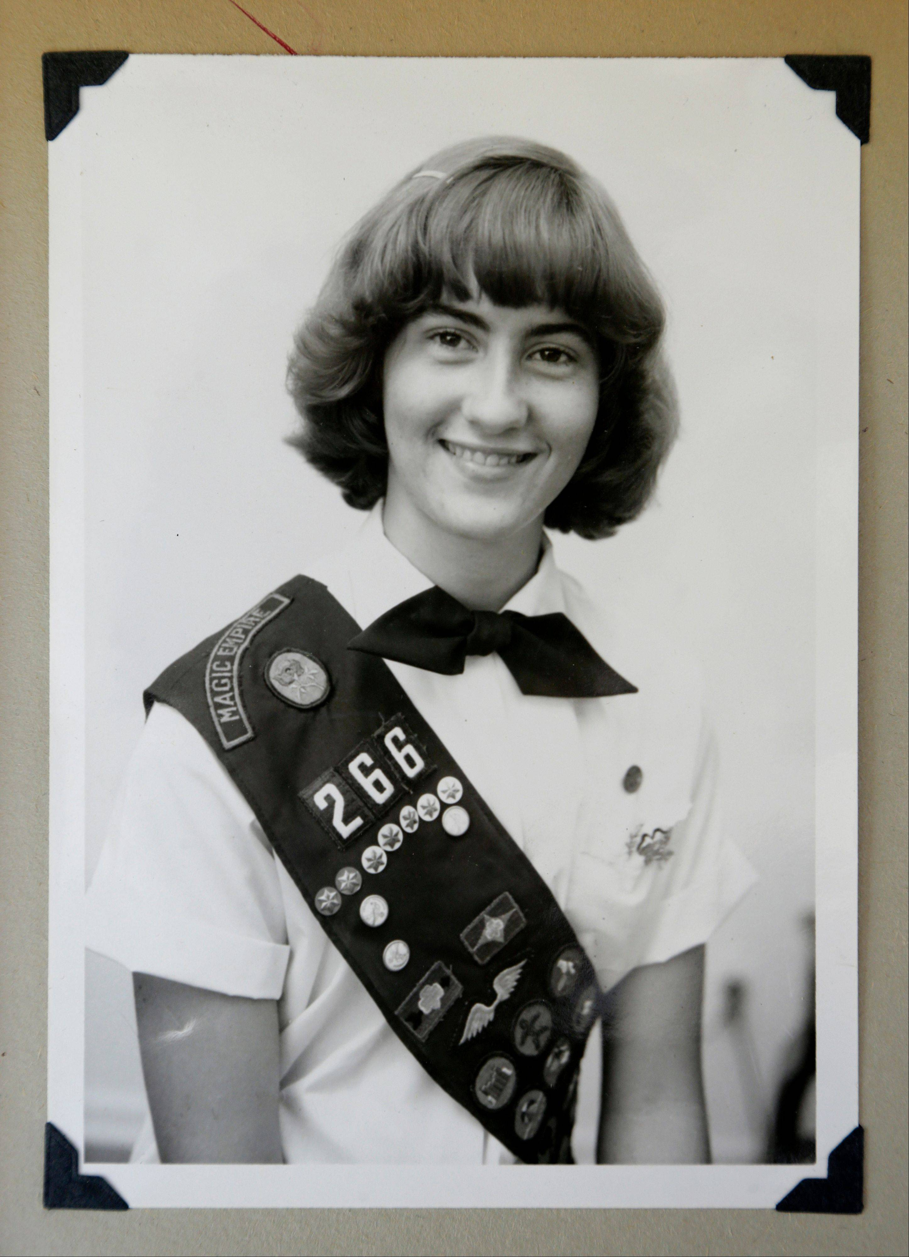 This 1973 family photo shows Joni Kinsey, of Iowa City, Iowa, in her Girl Scouts uniform. In an effort to save money, Girl Scout councils across the country are making proposals that would have been unthinkable a generation ago: selling summer camps that date back to the 1950s.
