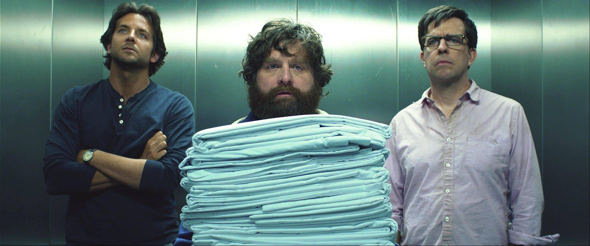 "This film publicity image released by Warner Bros. Pictures shows Bradley Cooper as Phil, left, Zach Galifianakis as Alan, center, and Ed Hlems as Stu in a scene from ""The Hangover Part III,"" which raked in $42 million at the box office."