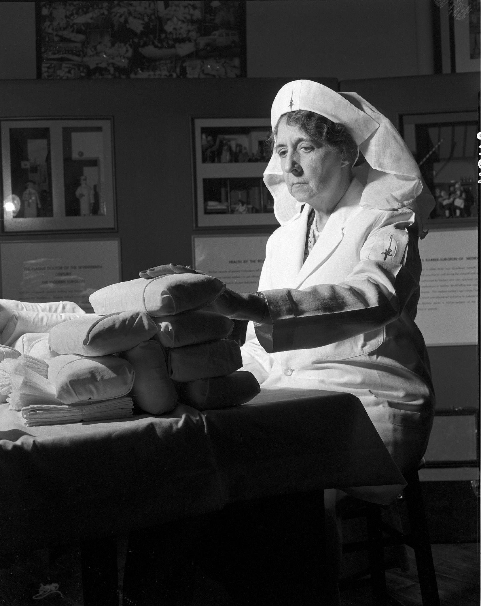 A Women's Field Army volunteer prepares surgical dressings. The Women's Field Army was an organization of women who took to the streets to educate people about cancer and raise money to save lives, helped build the American Cancer Society and the cancer movement.