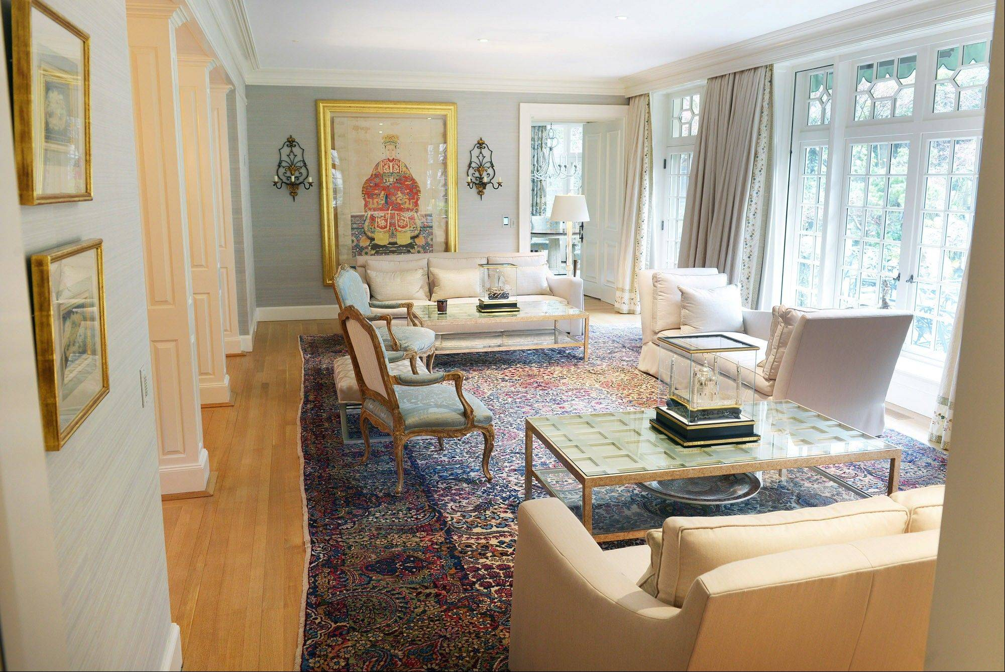 Choski's sitting room is seen at left. He can preset drapes in various rooms to open and close at precise times, which can help protect his rugs and furniture from harsh sunlight.