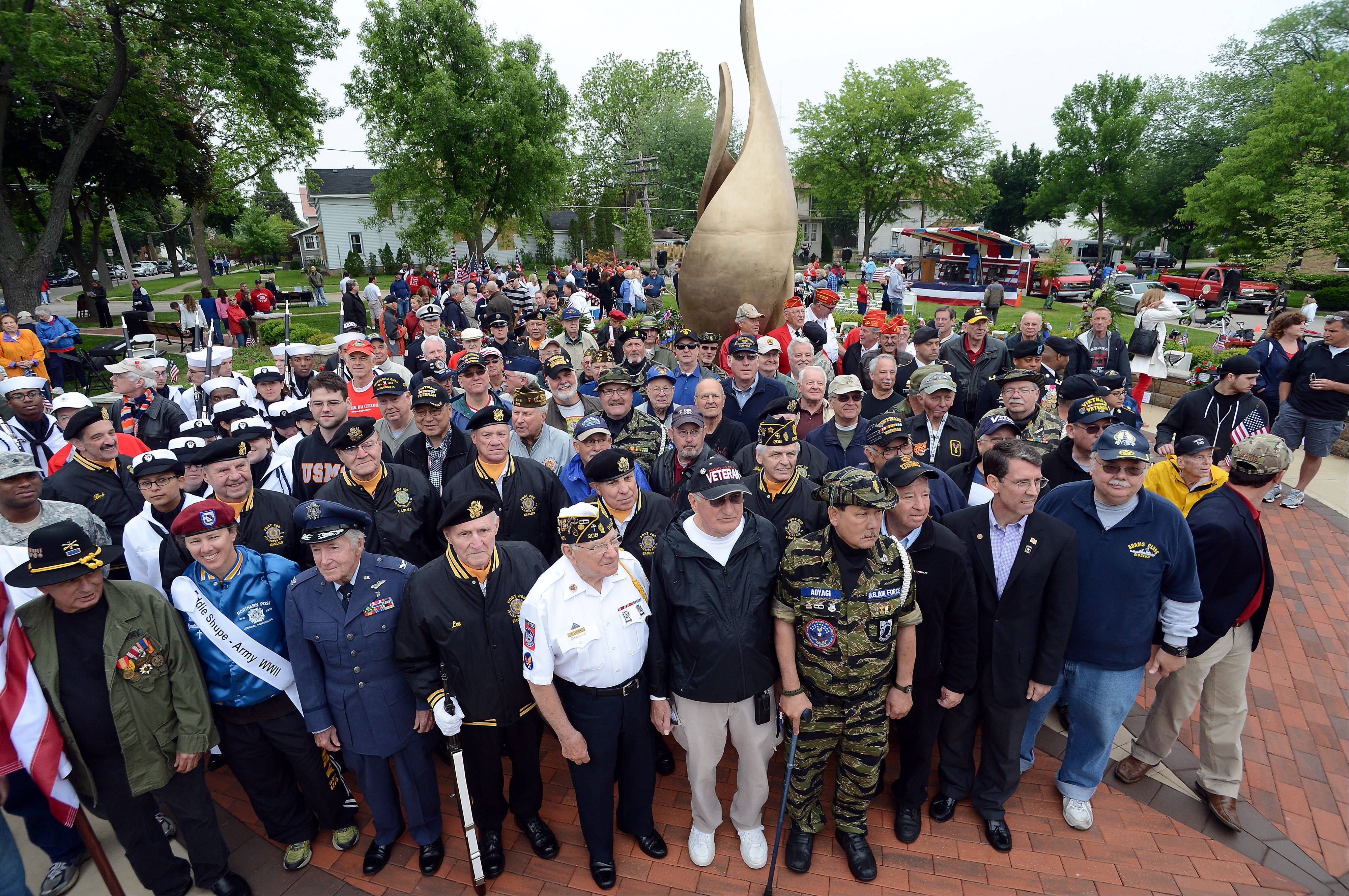 Veterans from all branches of the military gather Monday under the eternal flame in Memorial Park as part of Arlington Heights' Fallen Heroes Memorial Day Ceremony.