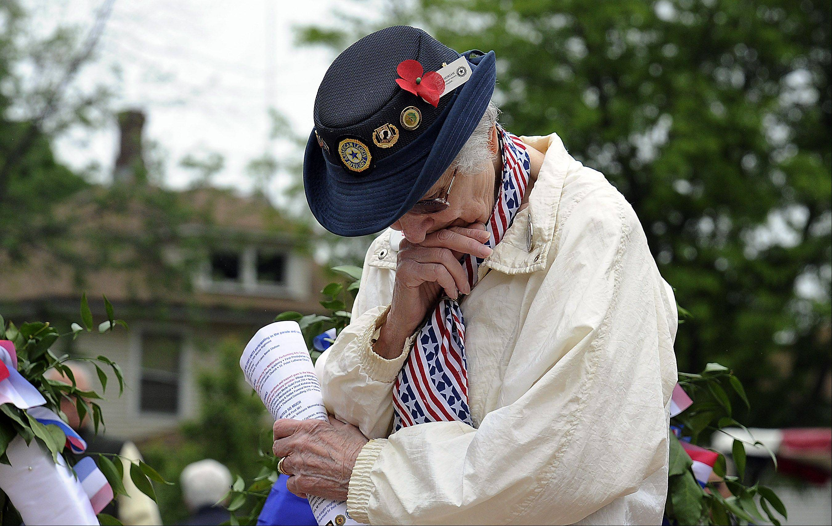 Dolly Cummings of Arlington Heights bows her head Monday during the Arlington Heights Memorial Day ceremony in remembrance of her fallen husband Don, who served in World War II and the Korean War.