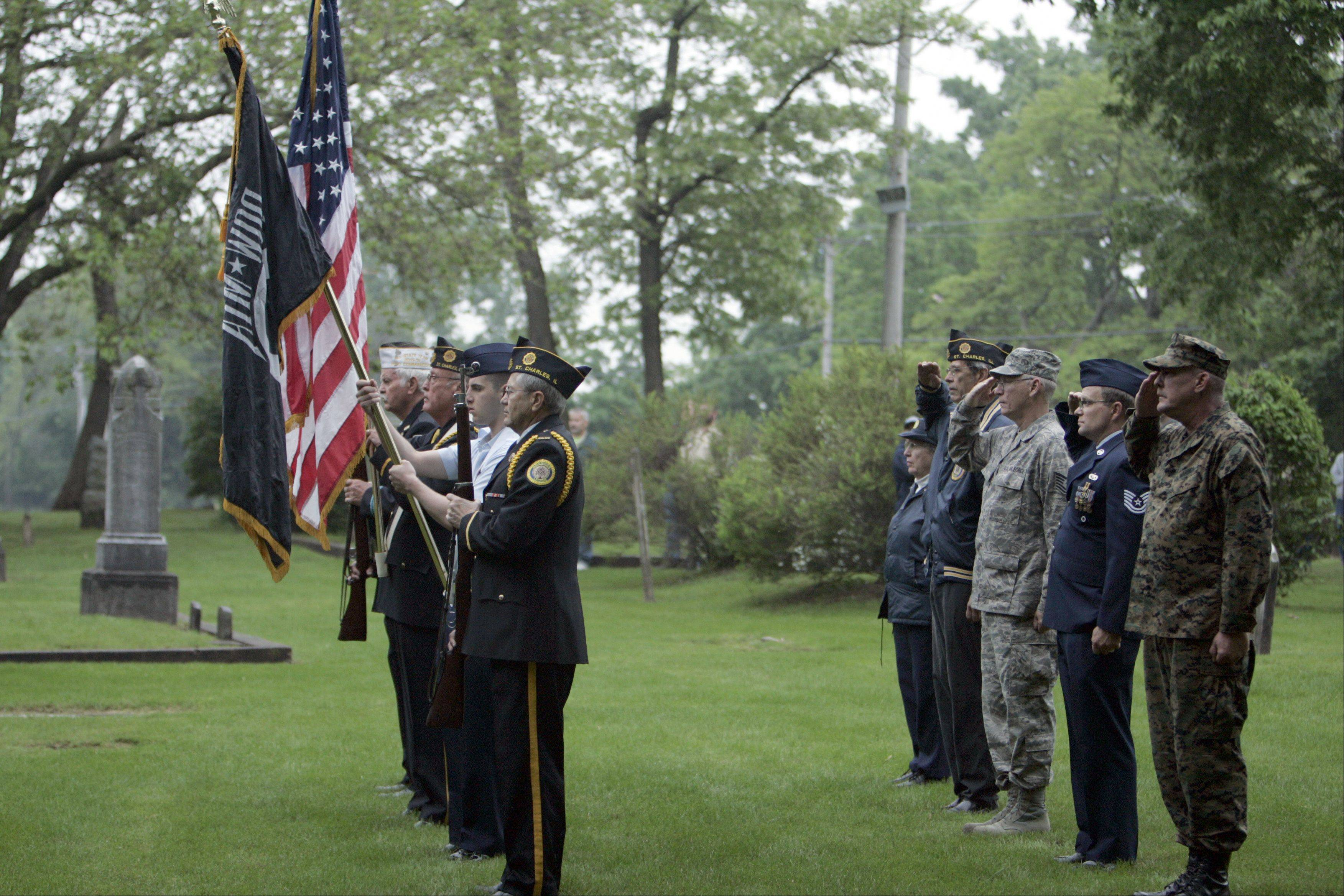 The color guard presents the colors during the Memorial Day celebration at South Cemetery in St. Charles early Monday morning.