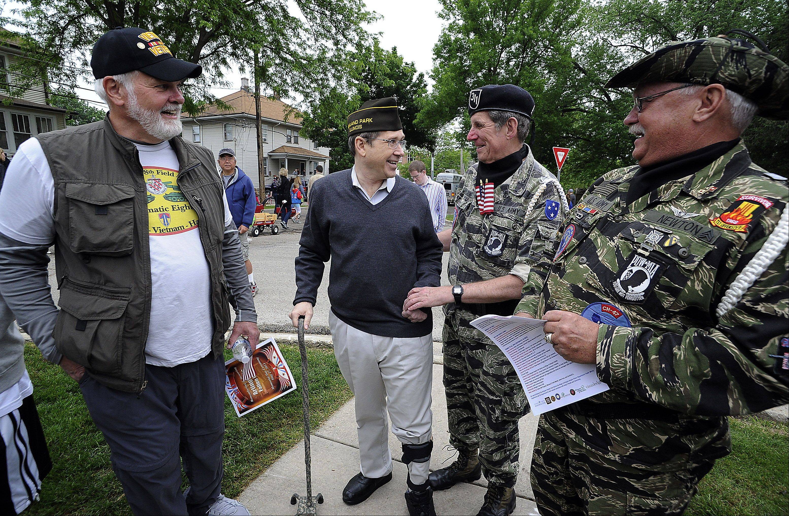 Senator Mark Kirk greets his fellow veterans in Arlington Heights Memorial Park as part of Arlington's Fallen Heroes Memorial Day Ceremony on Monday.