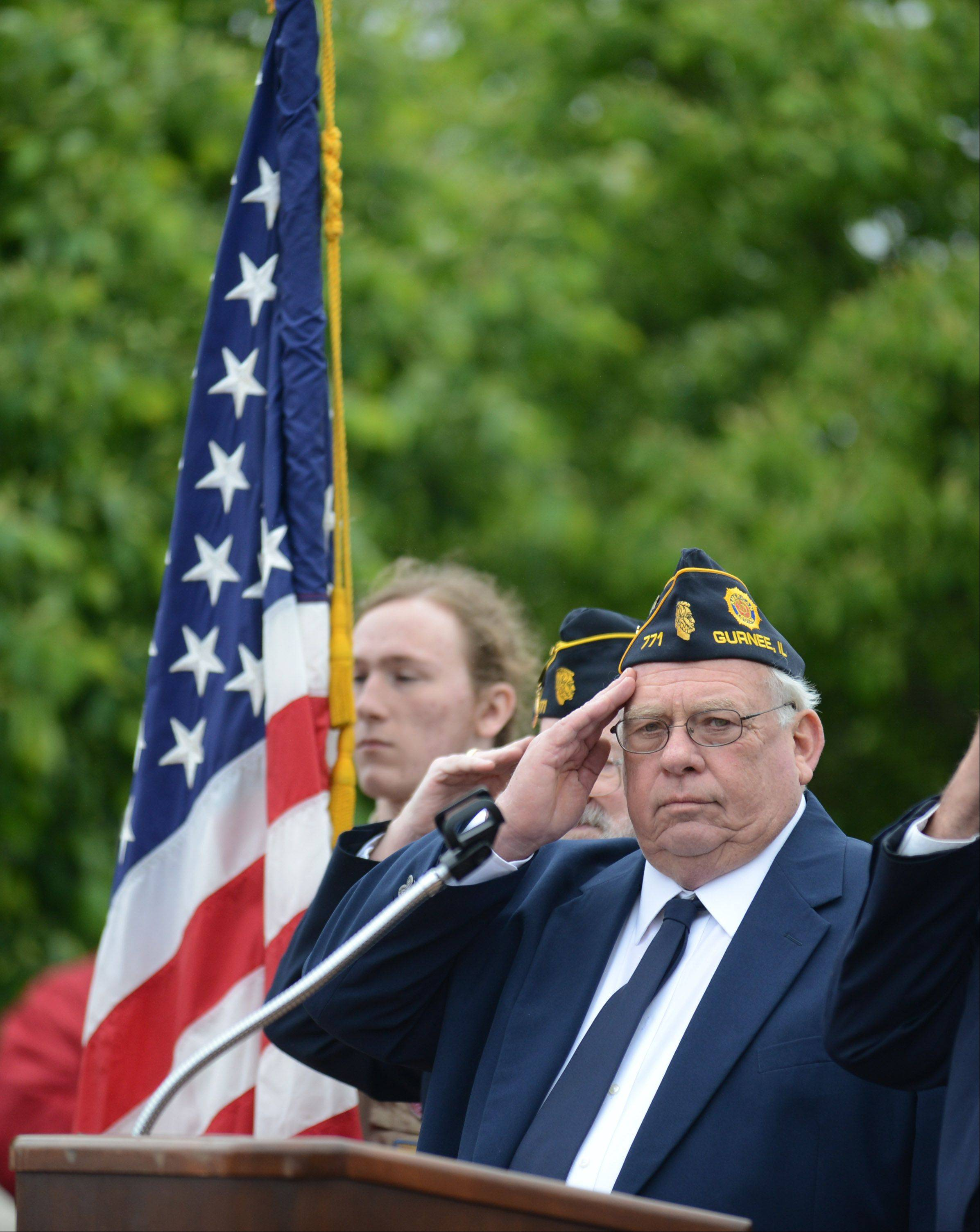 Gurnee American Legion Post 771 Cmdr. Gordon Finkel salutes during Monday's Memorial Day ceremony in Gurnee.