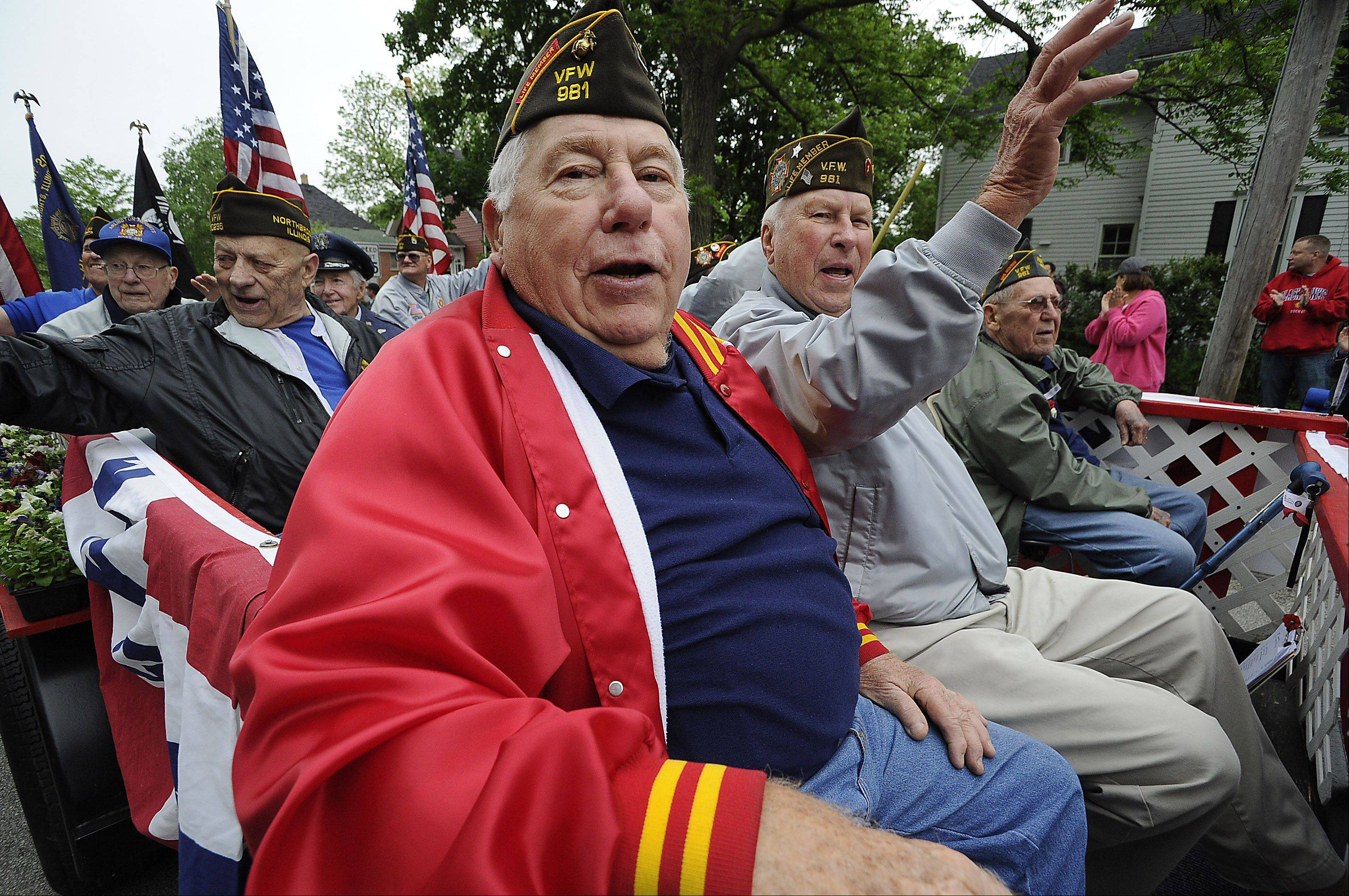 Chuck Shields of Arlington Heights and Leo Larson from Kildeer who are from the Veterans of Foreign War post 981 both served in the Korean War ride in the Arlington Heights parade as part of Arlington's Fallen Heroes Memorial Day Ceremony on Monday.