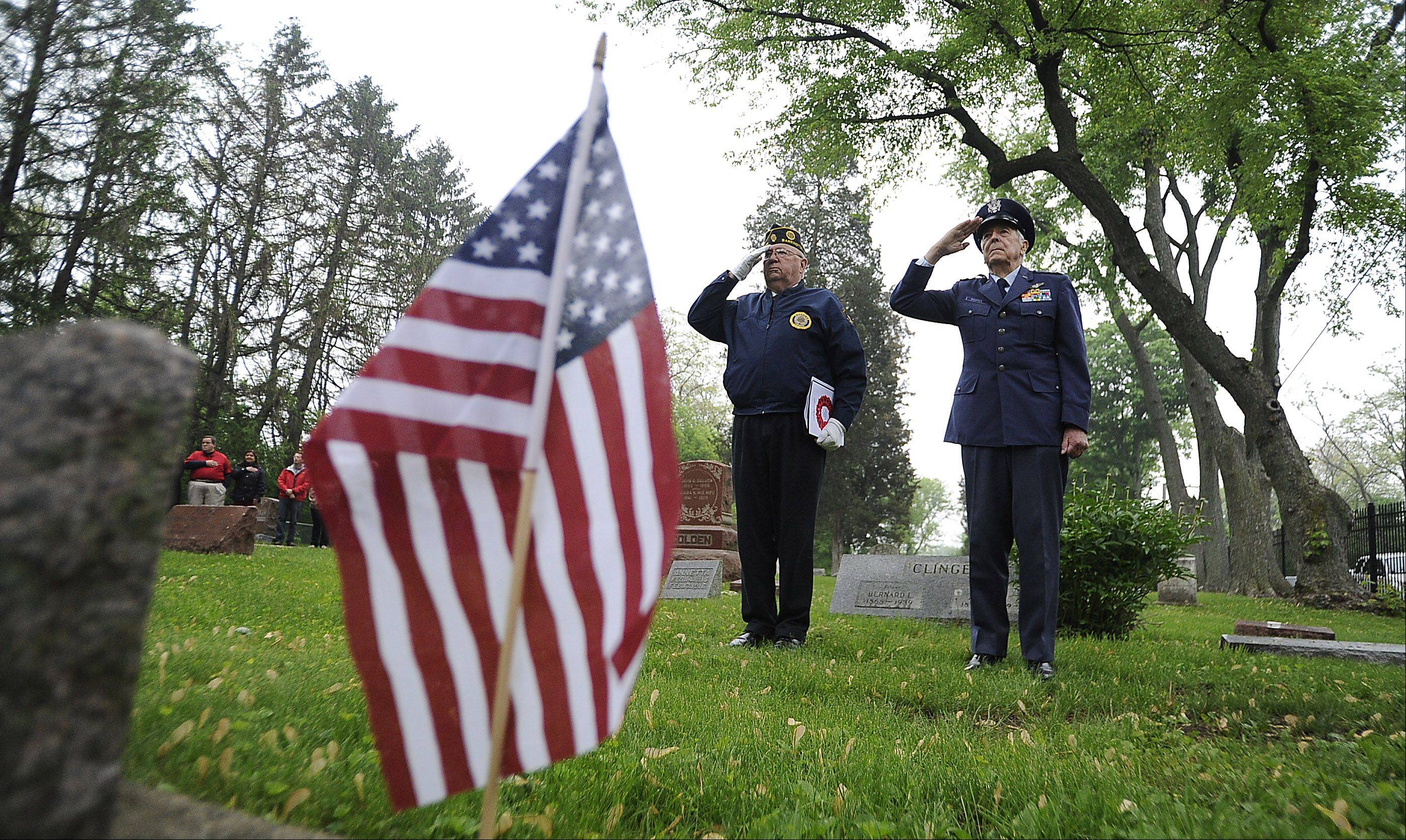 Bob Kruse of Barrington from American Legion 158 who served in the Korean War salutes along with Hal Richter of the Veteran of Foreign War post 7706 serving in Korea and World War II take part in the Memorial Day Ceremony at White Cemetery in Barrington on Monday.