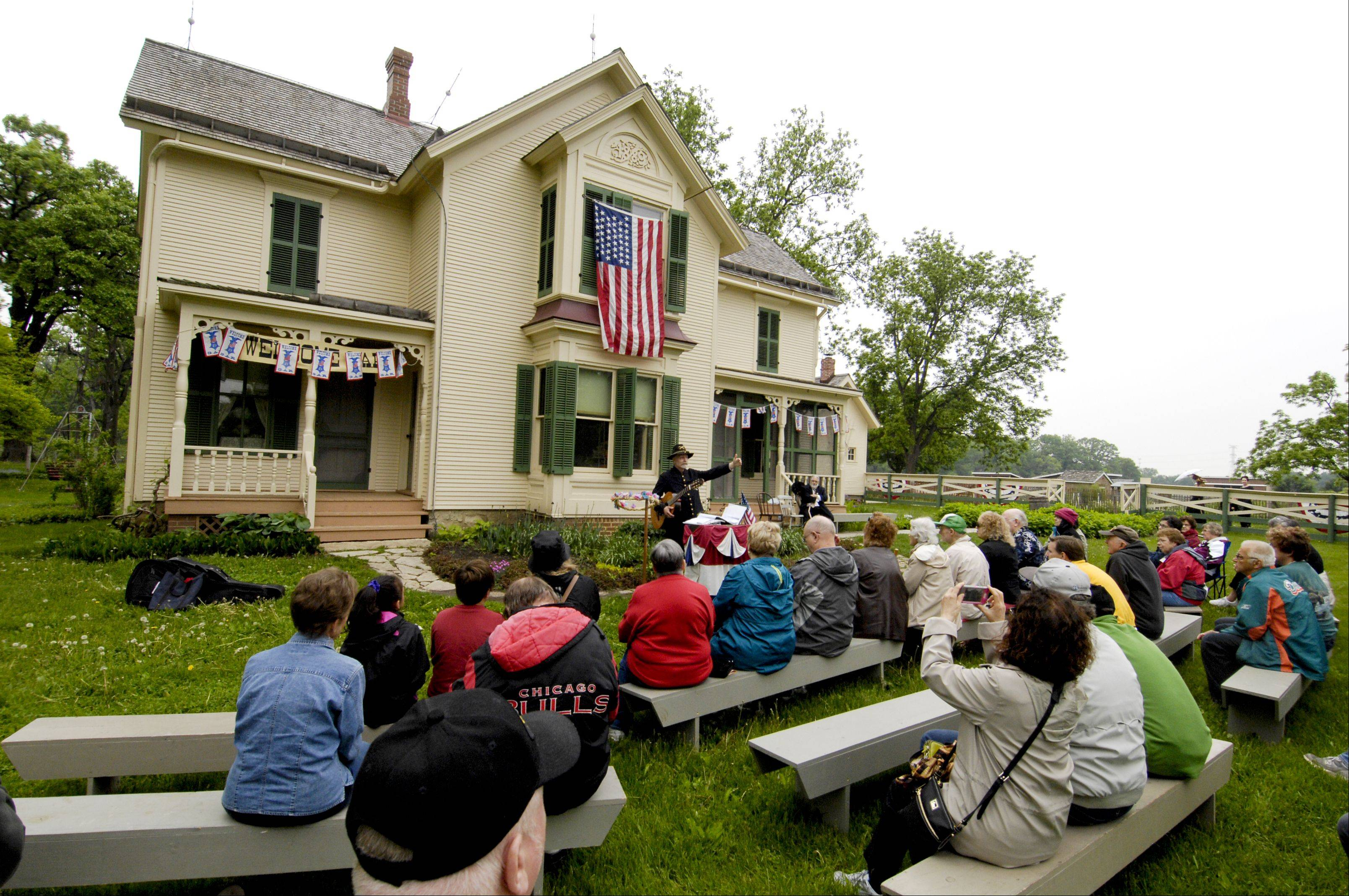 Roger Kotecki, sings songs of the Civil War during the Memorial Day Remembered event at Kline Creek Farm in West Chicago, Monday.