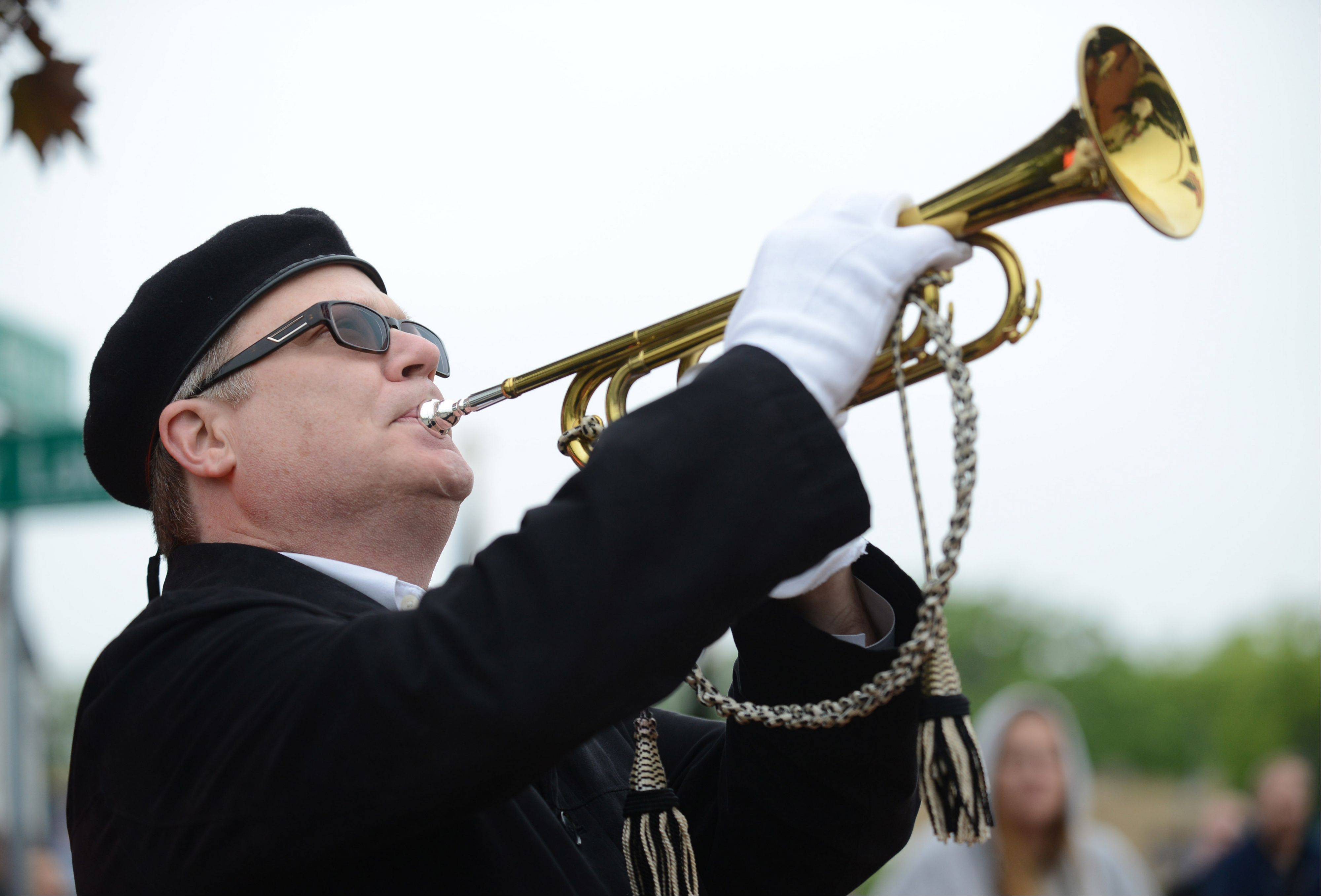 Bugler Gary Stoodley of Grayslake plays during Monday's Memorial Day ceremony in Round Lake.