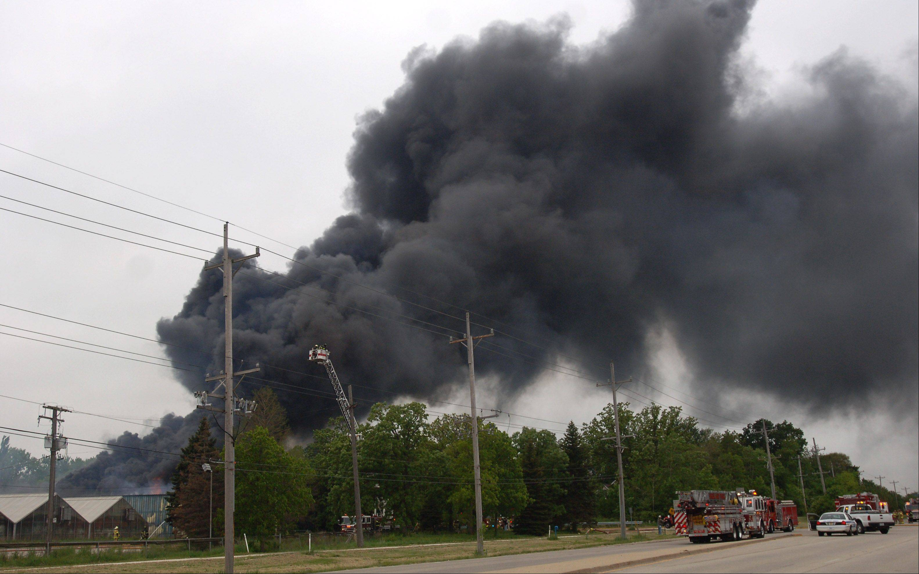 Heavy black smoke could be seen for miles Monday as buildings burned on the grounds of the former Jamaican Gardens nursery on Route 176 in Libertyville.