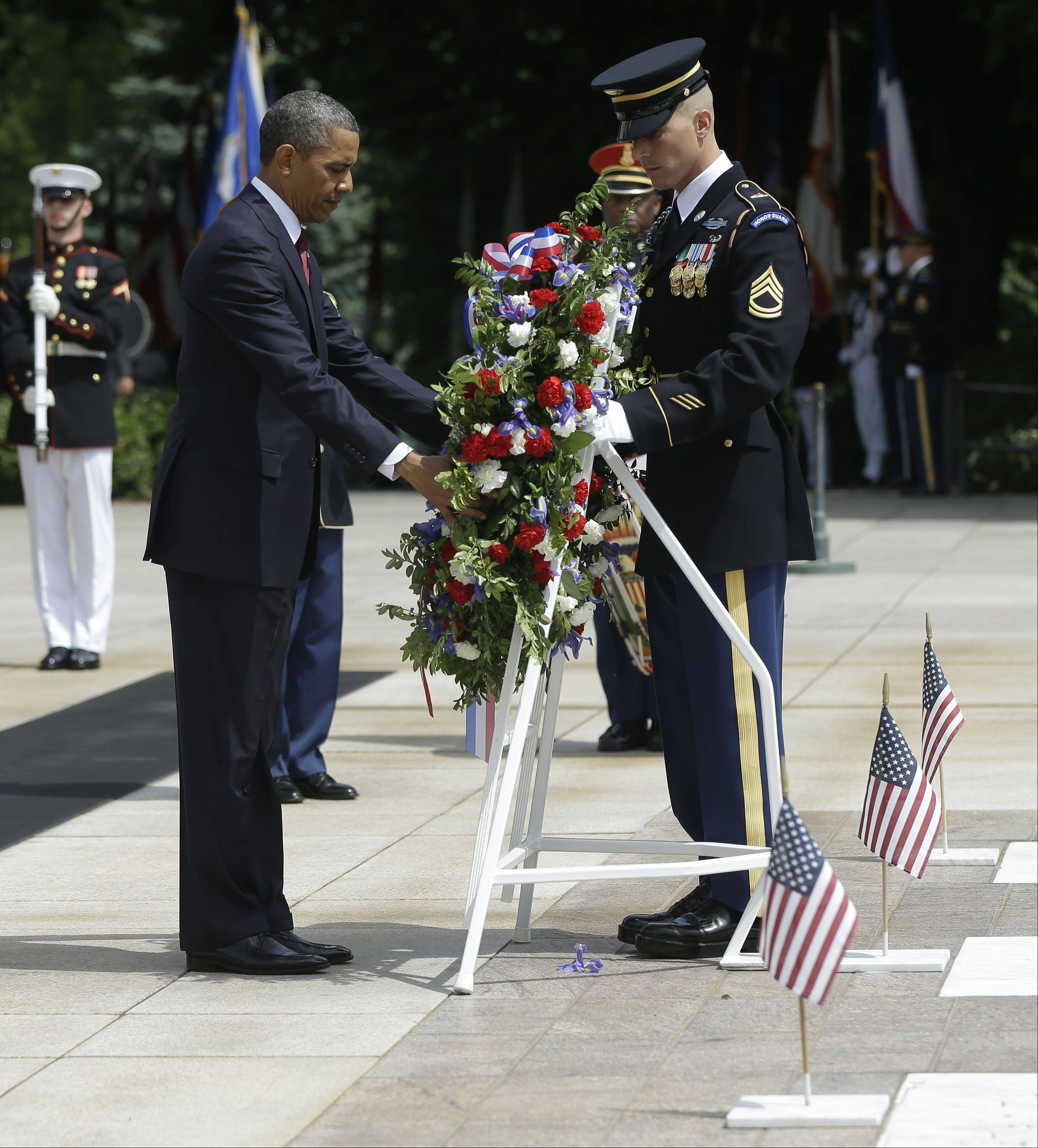 President Barack Obama participates in the wreath-laying ceremony at the Tomb of the Unknowns at Arlington National Cemetery on Memorial Day, May 27, 2013, in Arlington, Va.