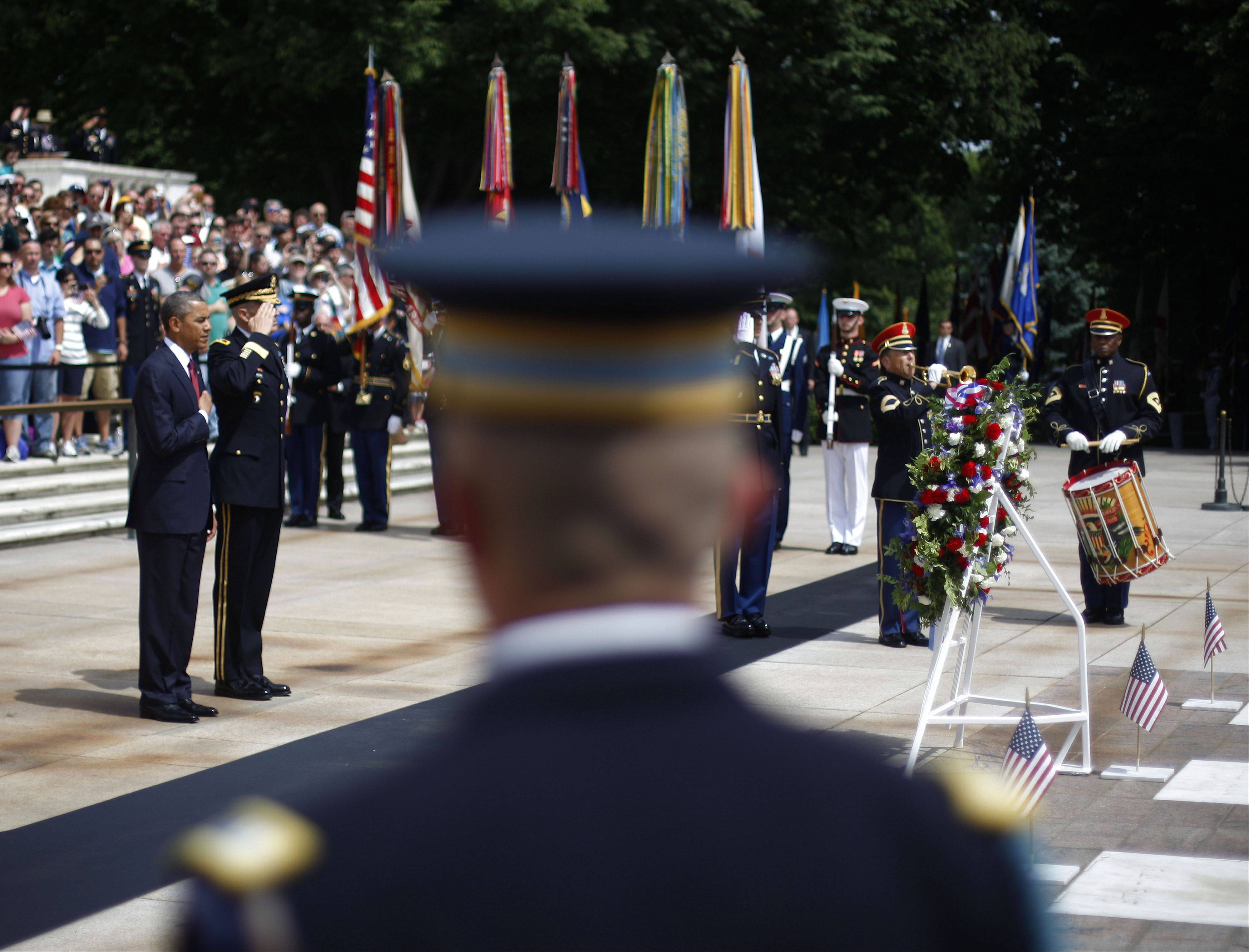 President Barack Obama, far left, participates in a wreath-laying ceremony at the Tomb of the Unknowns with Maj. Gen. Michael S. Linnington, Commander of the U.S. Army Military District of Washington, at Arlington National Cemetery on Memorial Day, May 27, 2013, in Arlington, Va.
