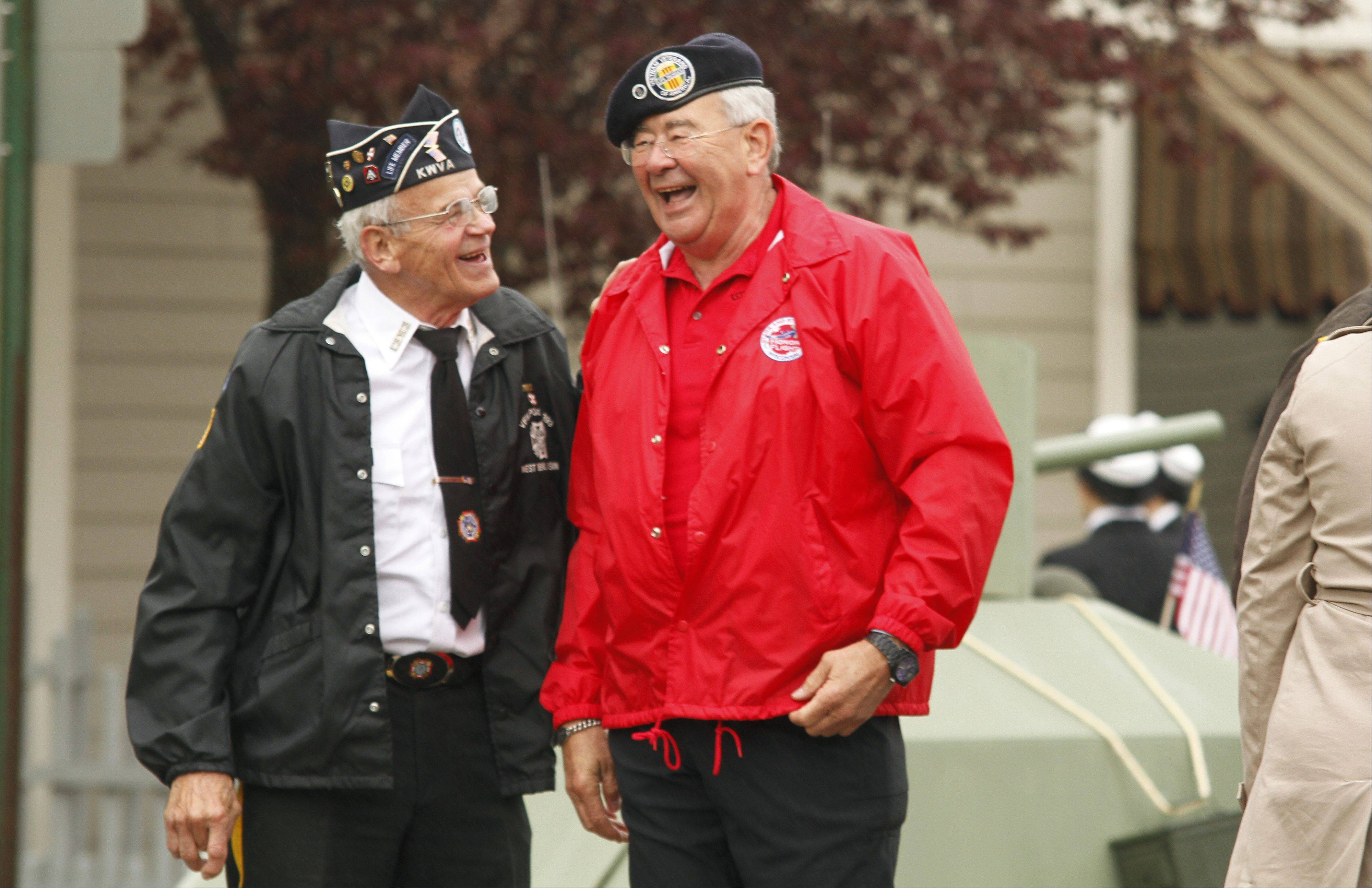 Korean War Veteran Merlin Stockhausen of West Bend, left, talks with Air Force Veteran Richard Lindbeck before the Memorial Day parade in West Bend on Monday, May 27, 2013.