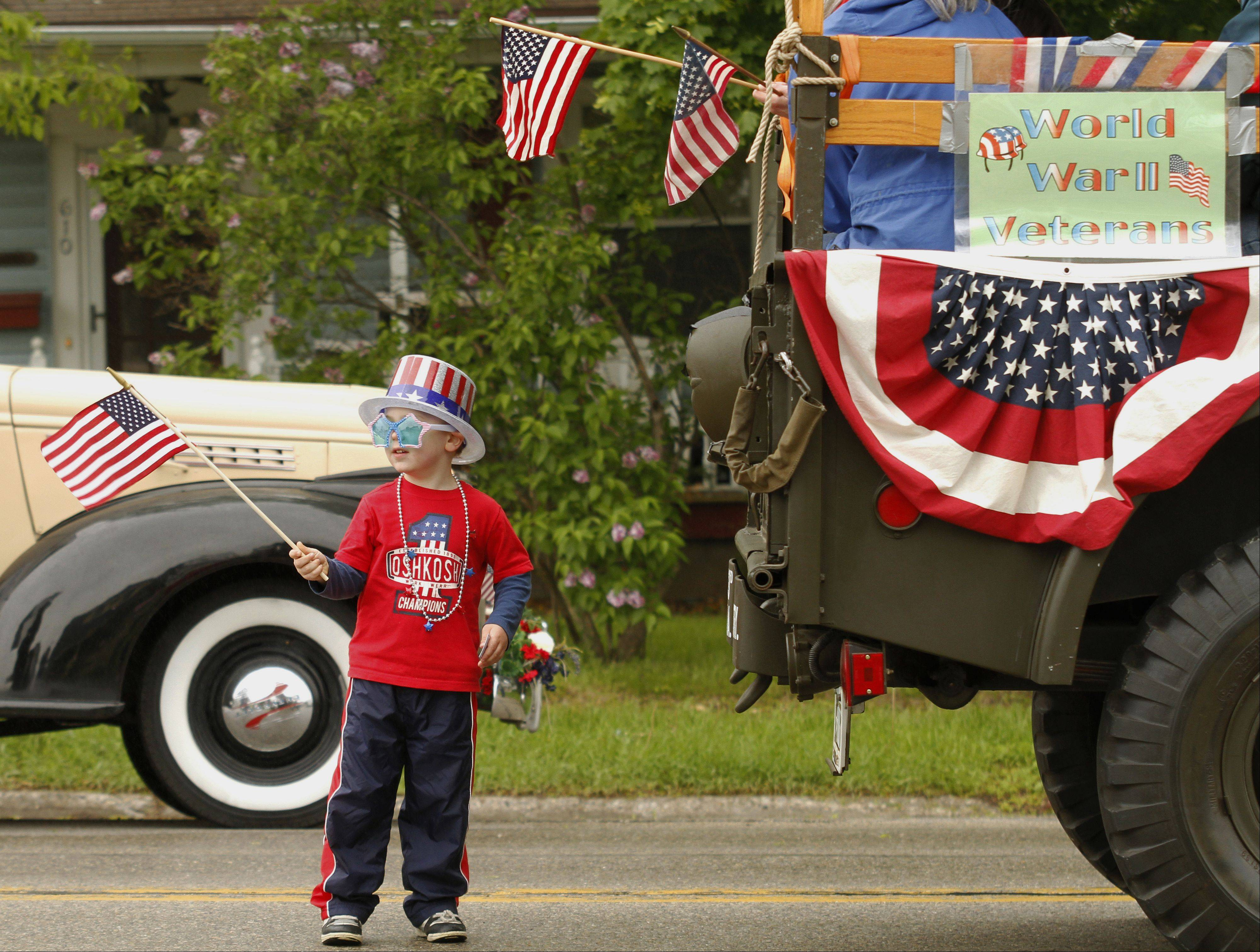 Jacob Webster, 4, of West Bend waits for the Memorial Day parade to begin in West Bend on Monday, May 27, 2013.