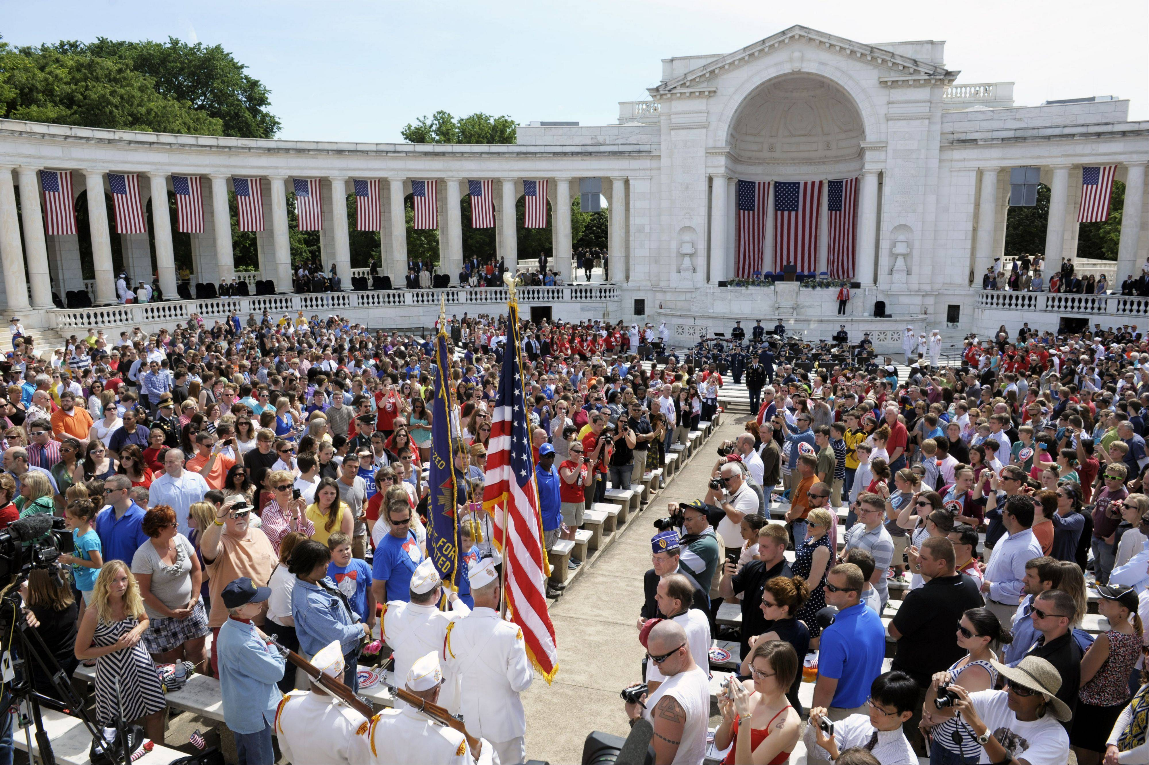 An honor guard presents the colors ahead of President Barack Obama delivering his Memorial Day address at Arlington National Cemetery in Arlington, Va., Monday, May 27, 2013.