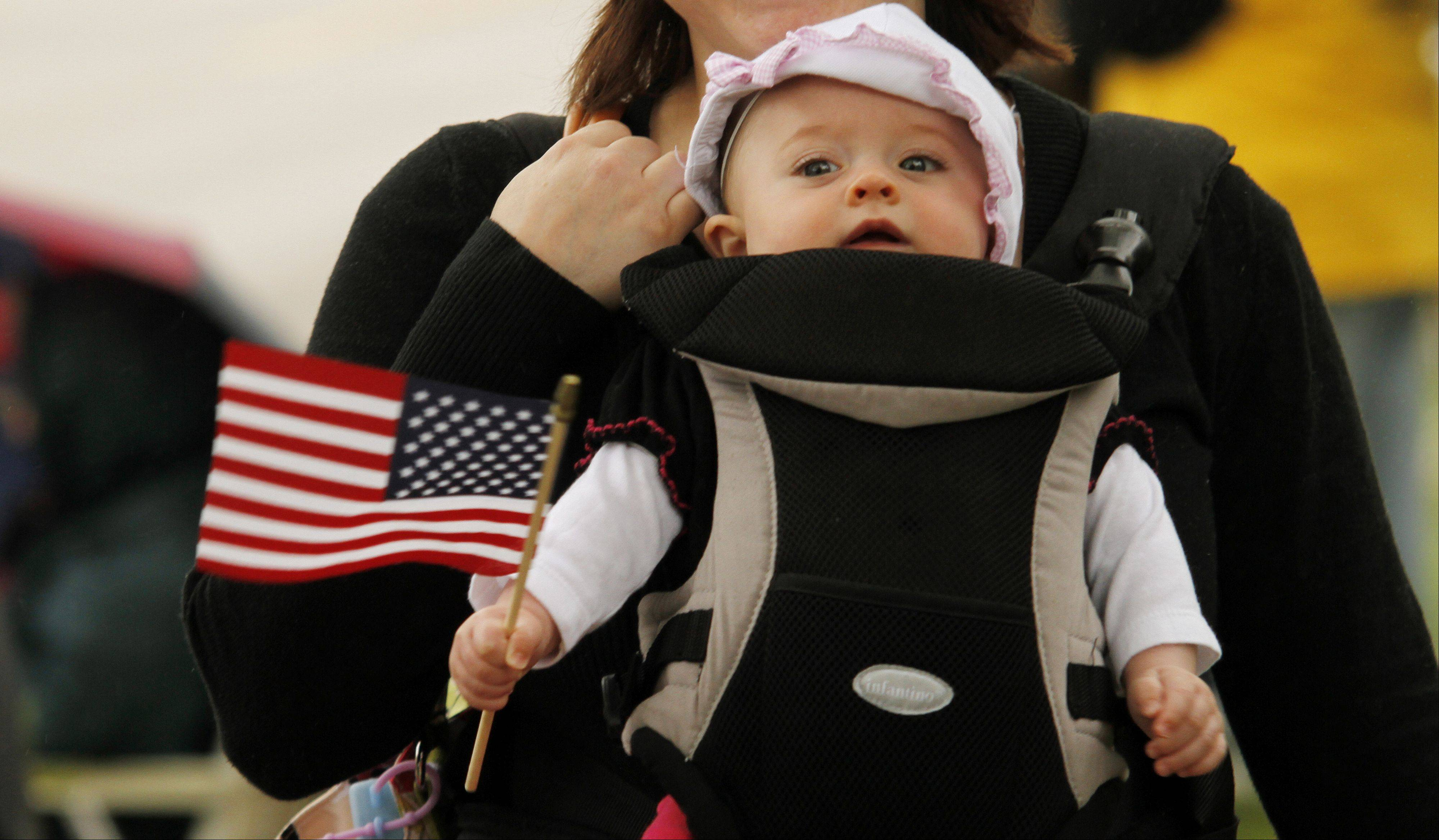 Cora Jacoby, six-months old, of Fond du Lac, Wis., waves her flag during the Memorial Day parade in West Bend on Monday, May 27, 2013.