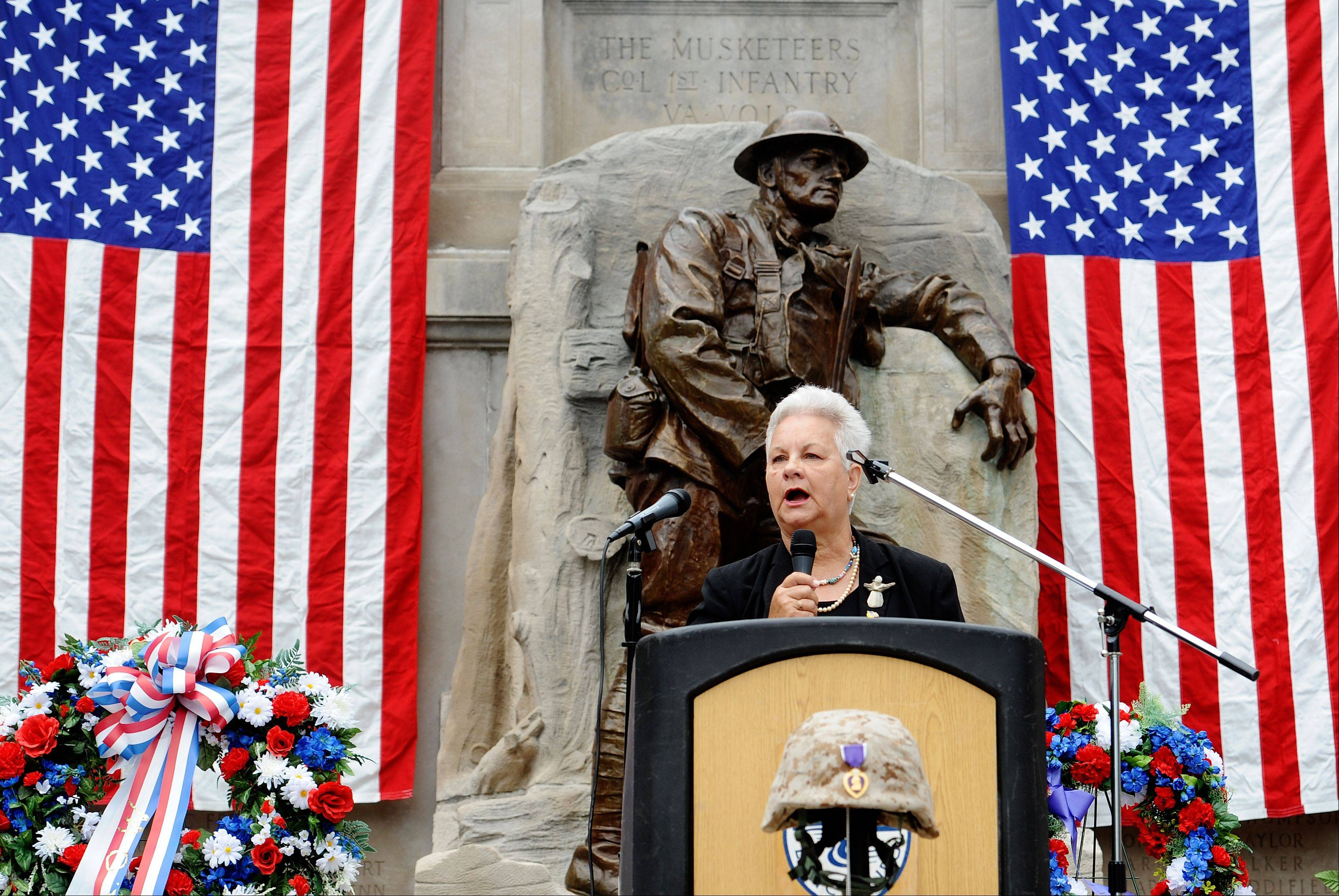 Rev. Sue Knipp takes the stage as Monday's guest speaker at the Memorial Day service in Lynchburg, Va., Monday, May 27, 2013.