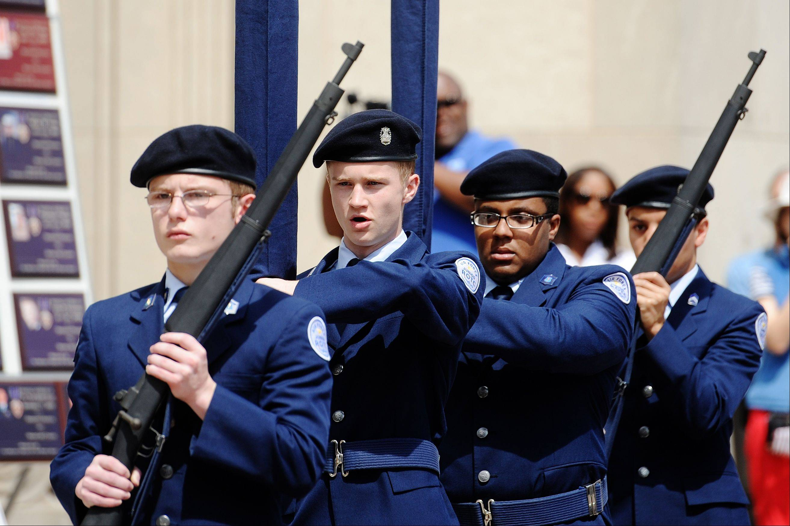 The E.C. Glass AFJROTC color guard presents the colors to begin the Memorial Day observance, Monday, May 27, 2013 in Lynchburg, Va.