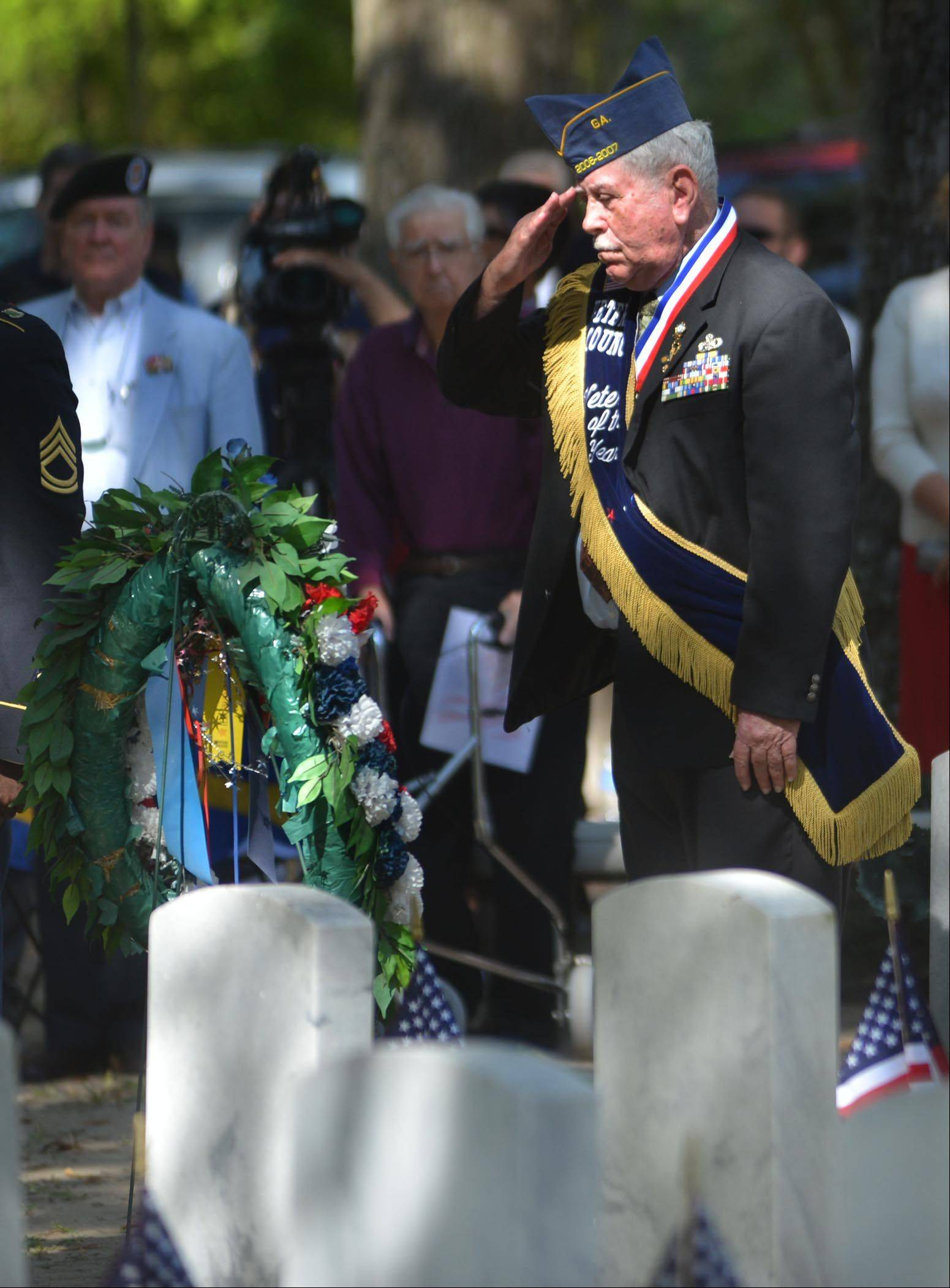 Chatham County Veteran of the Year Jim Vaughan salutes after laying a wreath during Memorial Day ceremonies at Bonaventure Cemetery in Savannah, Ga., Monday, May 27, 2013.